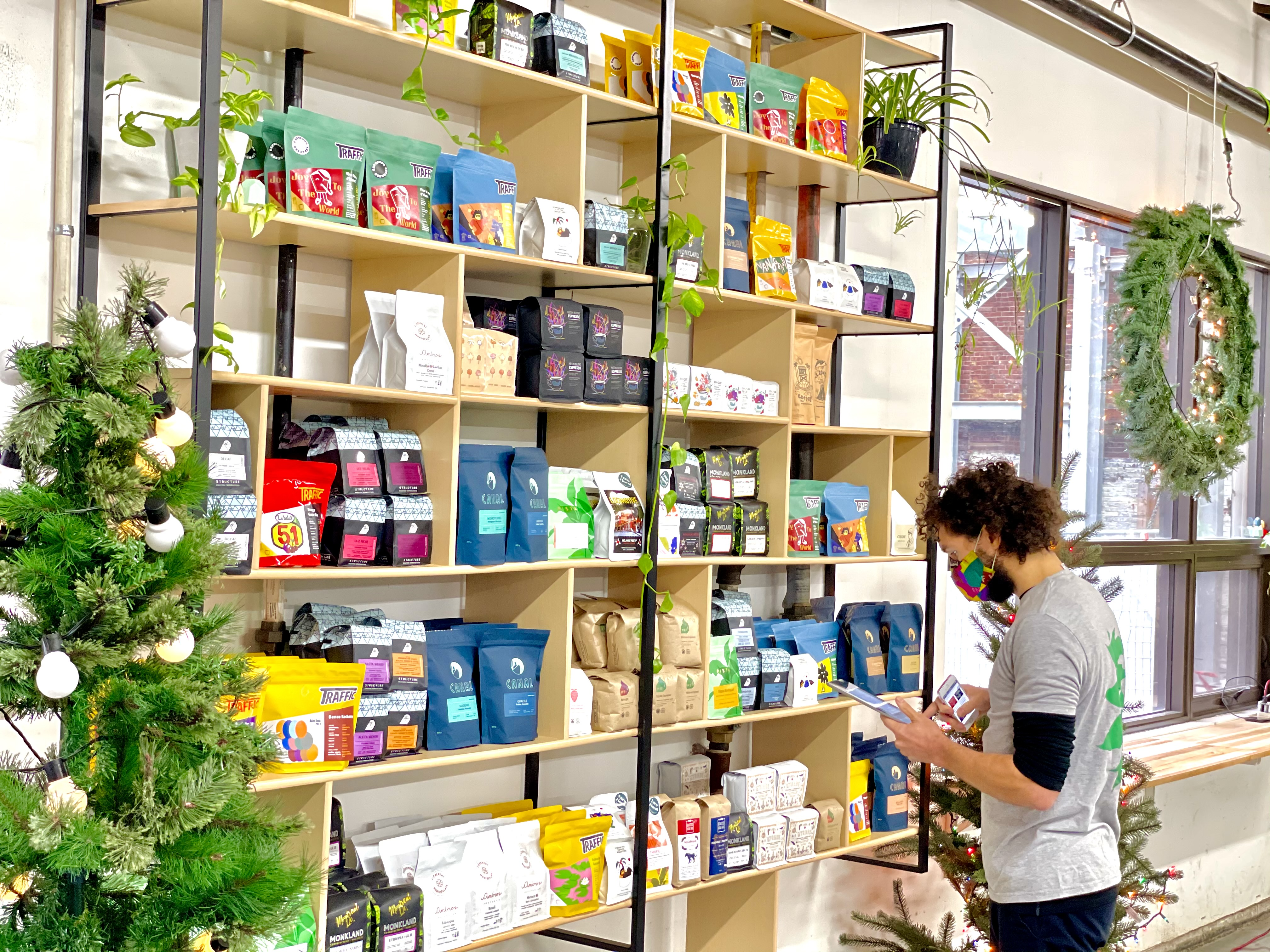 person browsing shelves stocked with coffee
