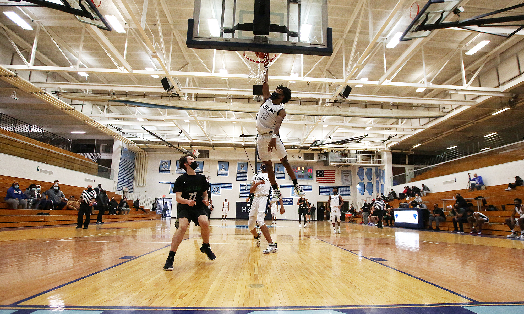 Hillcrest's Kenton Wright (11) goes up for a dunk against Oak Lawn.