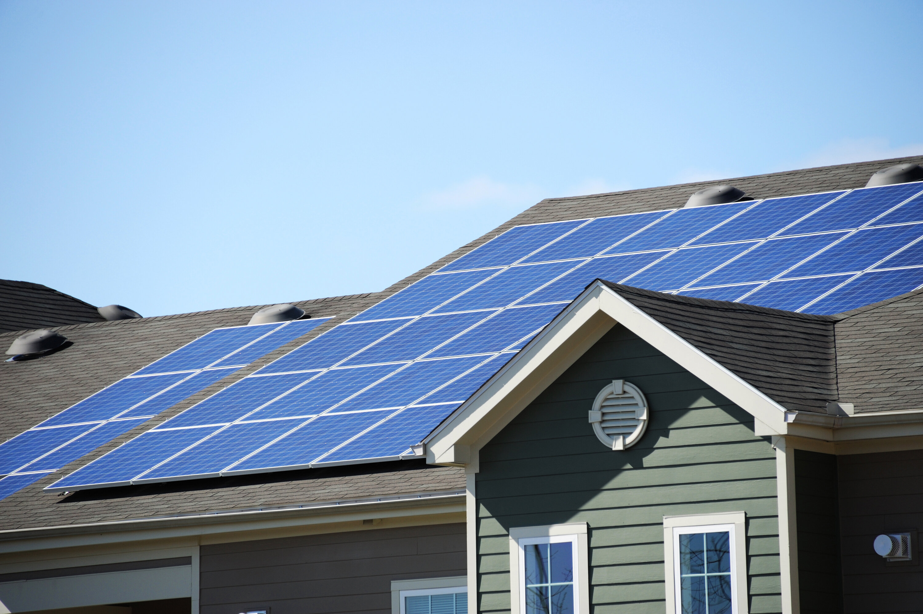 Sun panels on the roof of a green home.