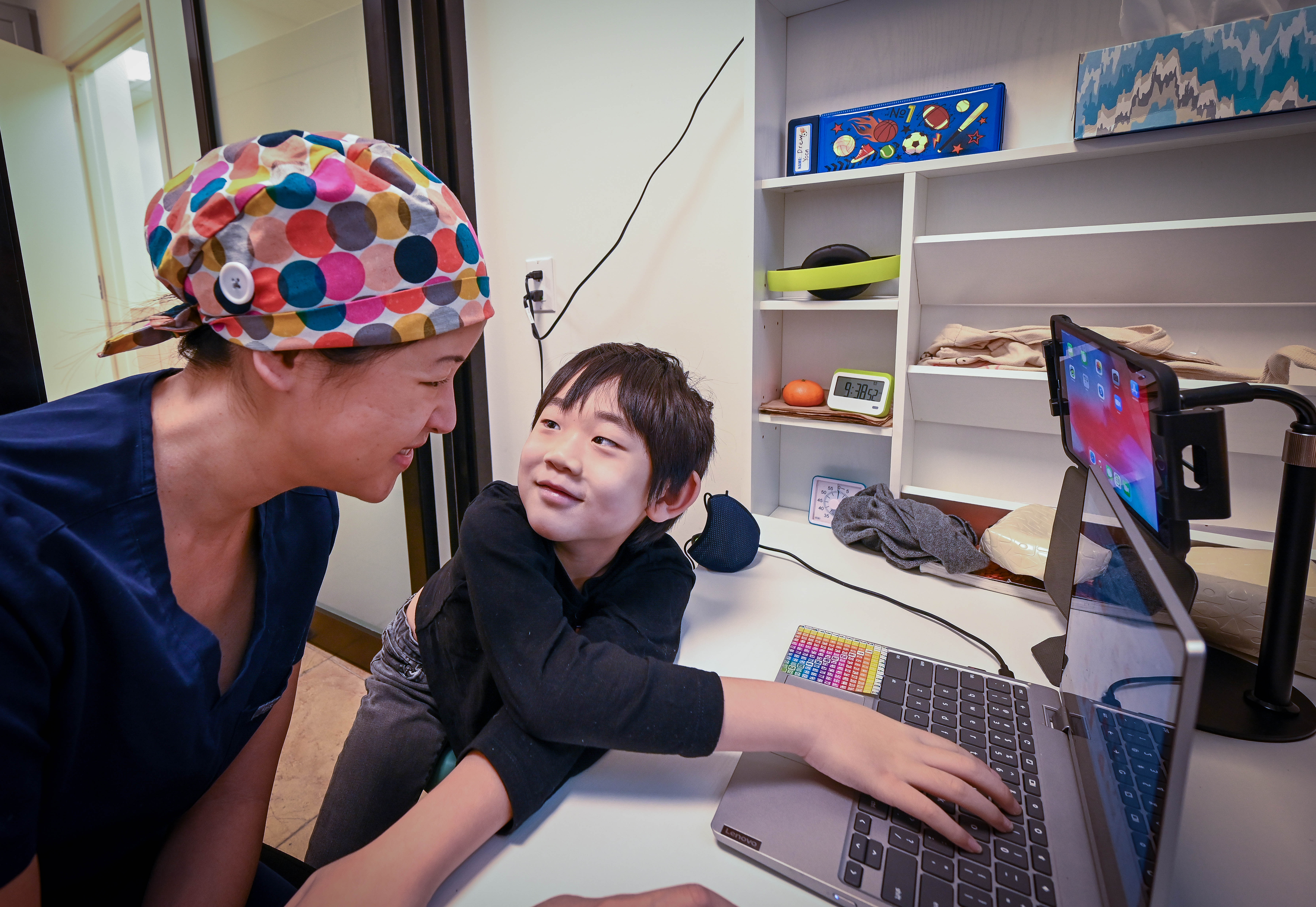 Nancy King is a NYC Ear, Nose and Throat doctor who has been taking her son Drew to her small office to do his online schooling.
