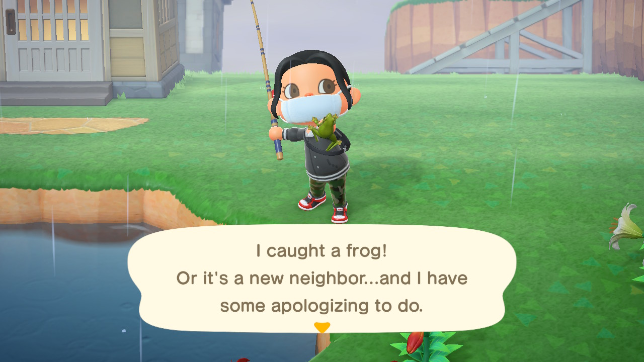 An Animal Crossing character holds up a freshly caught frog