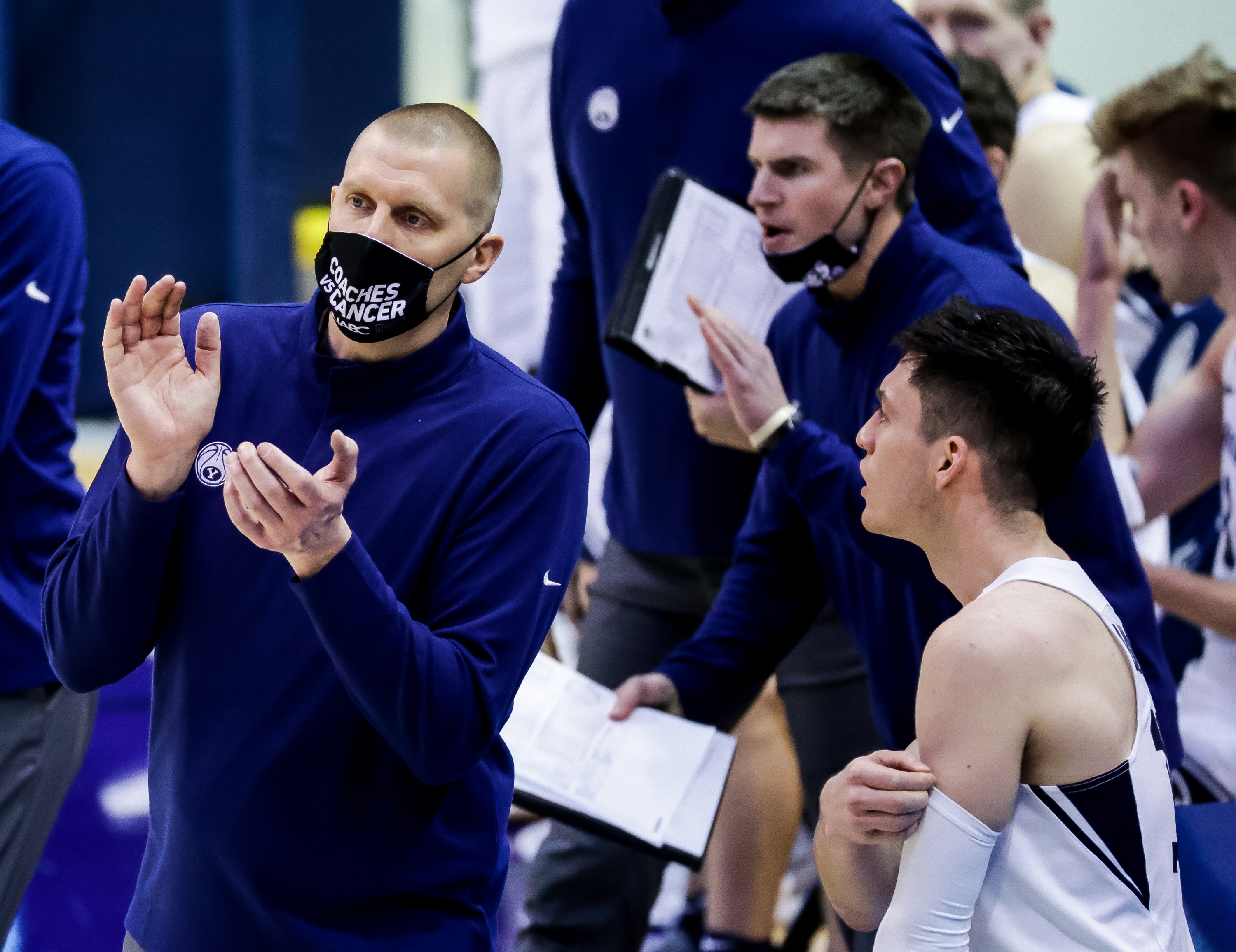 BYU coach Mark Pope claps on the sideline of a game against the Pacific Tigers at the Marriott Center in Provo.