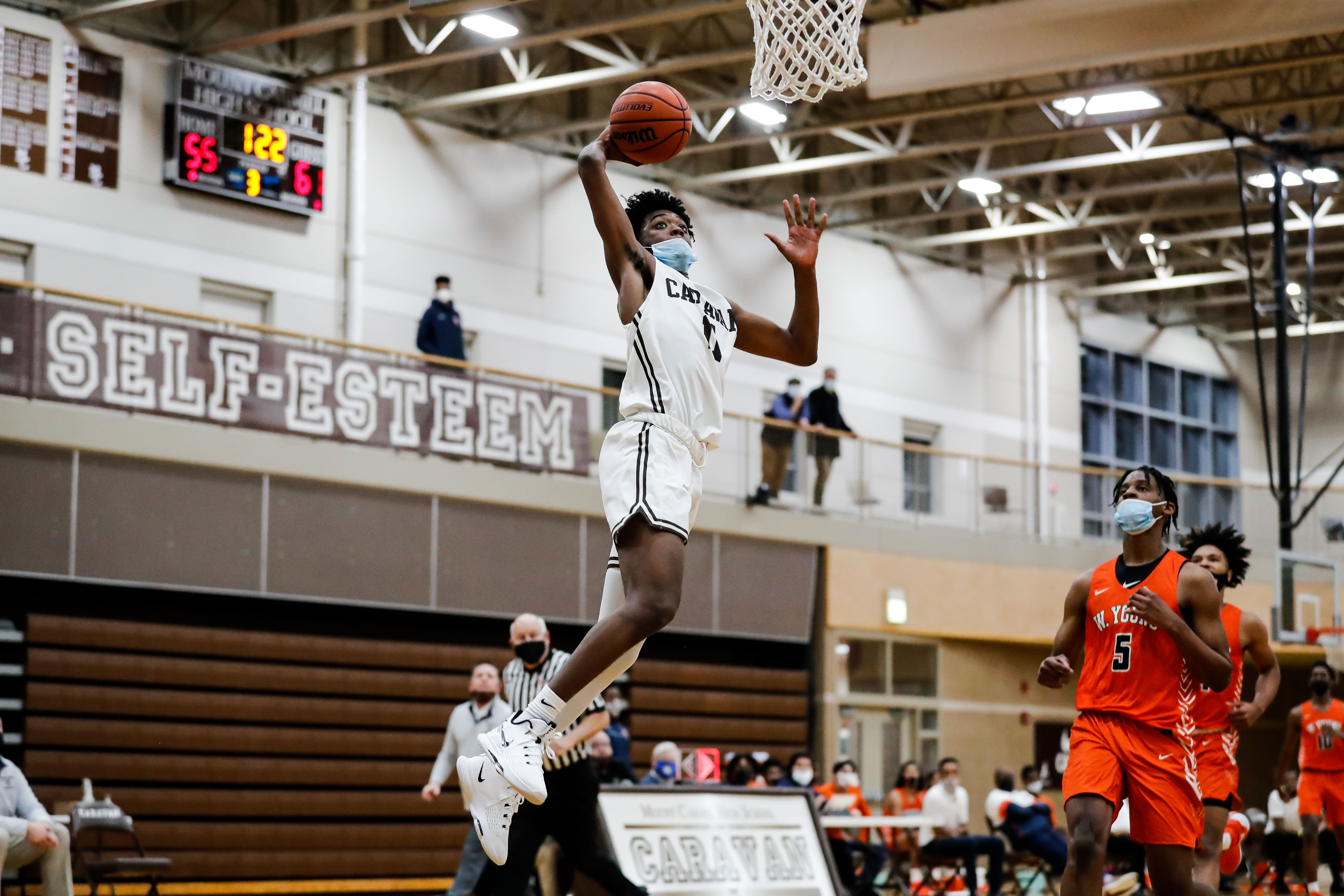 Mount Carmel's Myles Griffith (11) goes to the basket over Young.