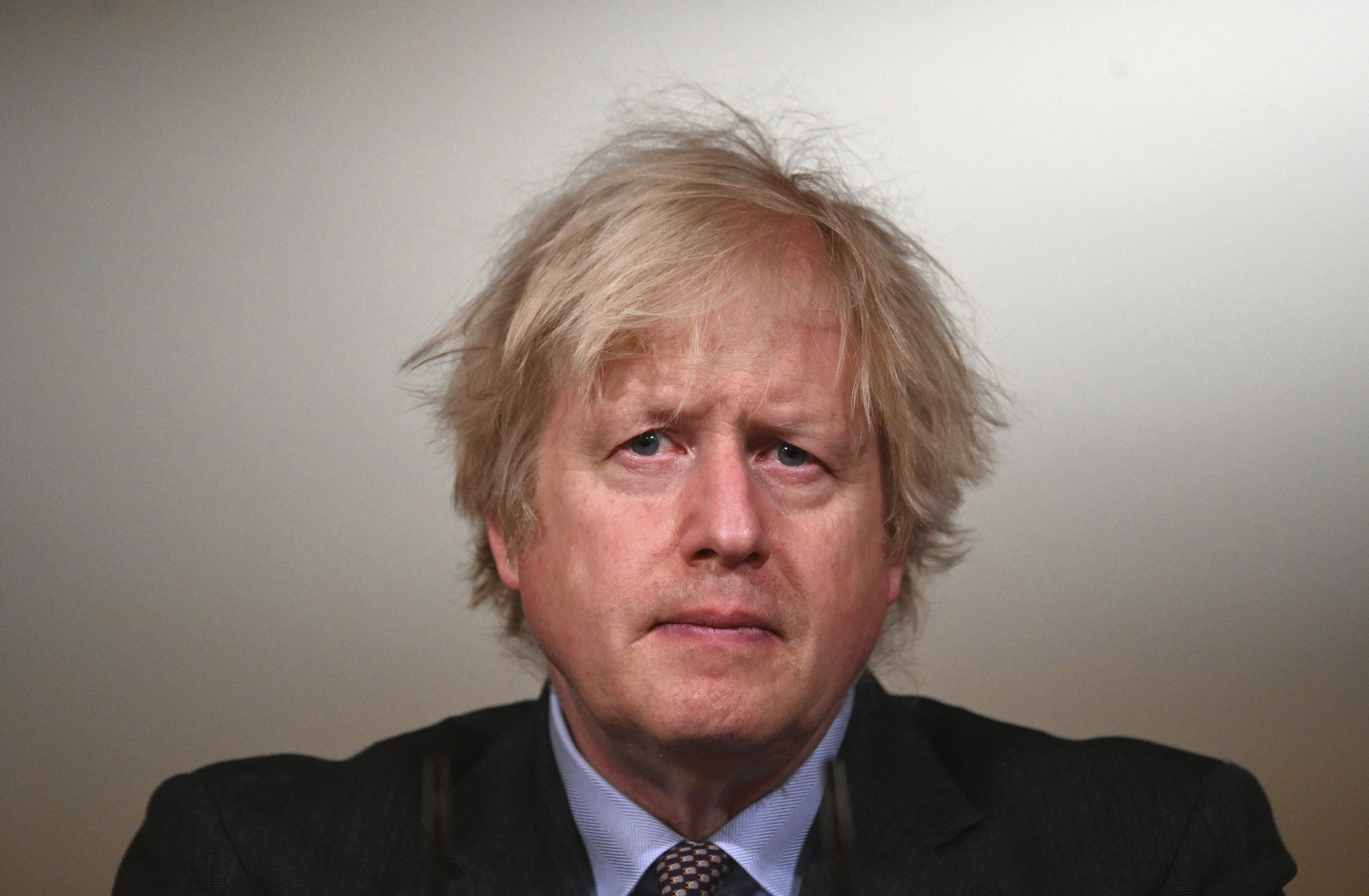 Britain's Prime Minister Boris Johnson speaks during a televised press conference at 10 Downing Street in London, Monday, Feb. 22, 2021.