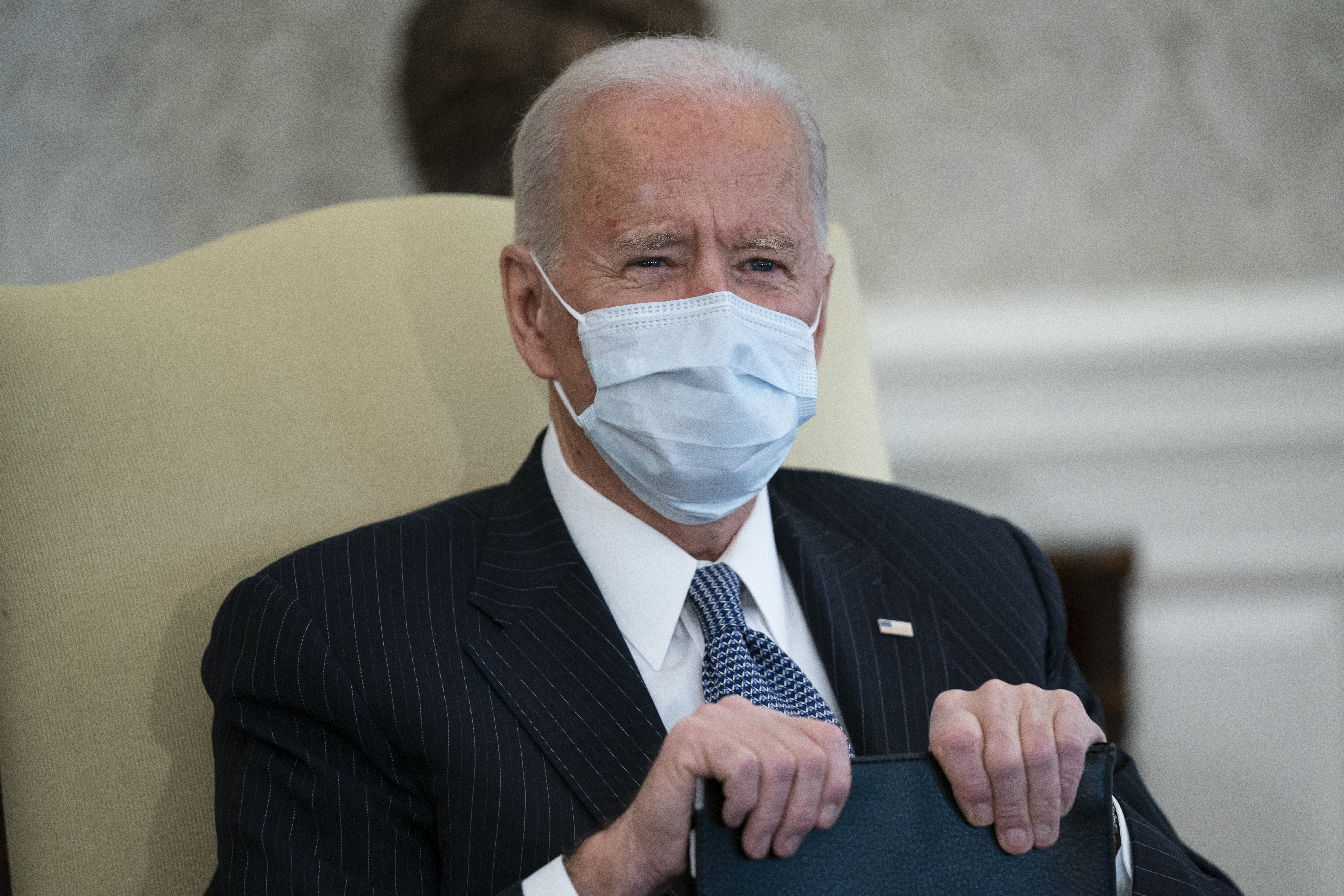 In this Feb. 3, 2021, file photo President Joe Biden meets with Senate Majority Leader Sen. Chuck Schumer of N.Y., and other Democratic lawmakers to discuss a coronavirus relief package, in the Oval Office of the White House in Washington.