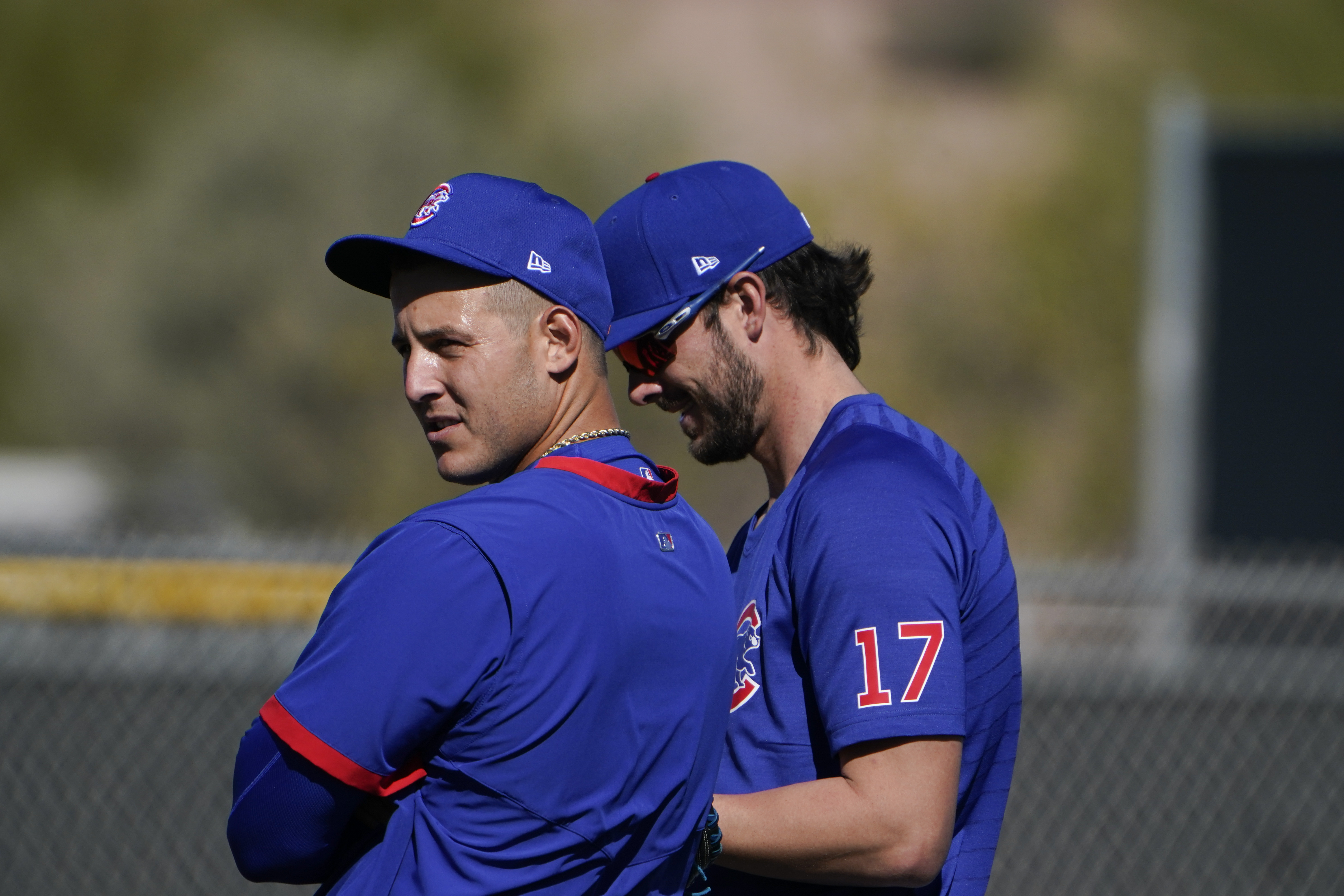 Anthony Rizzo (left) stands next to Kris Bryant during Monday's spring training workout in Mesa, Arizona.