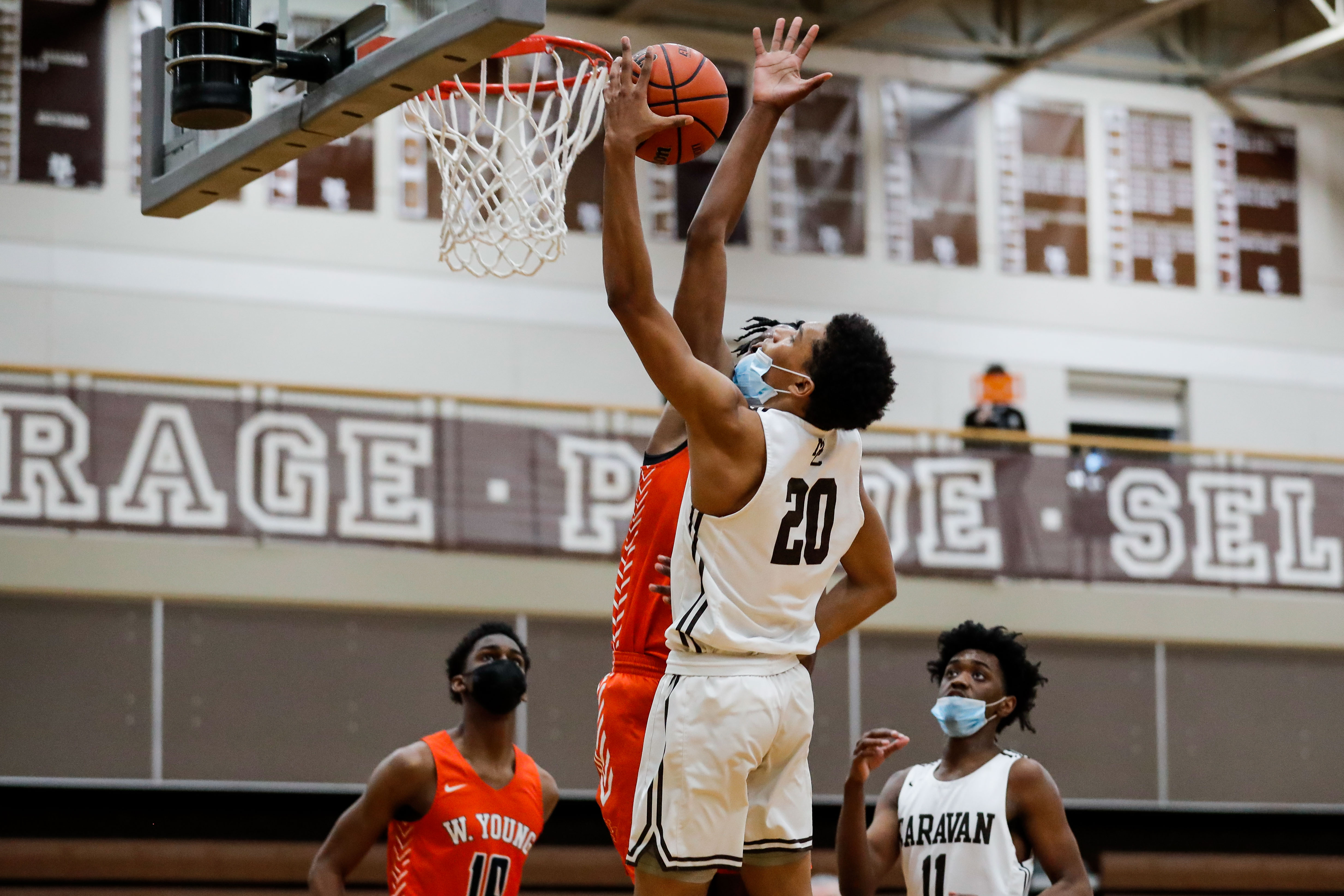 Mount Carmel's Grant Mason (20) goes up for a basket against Young.