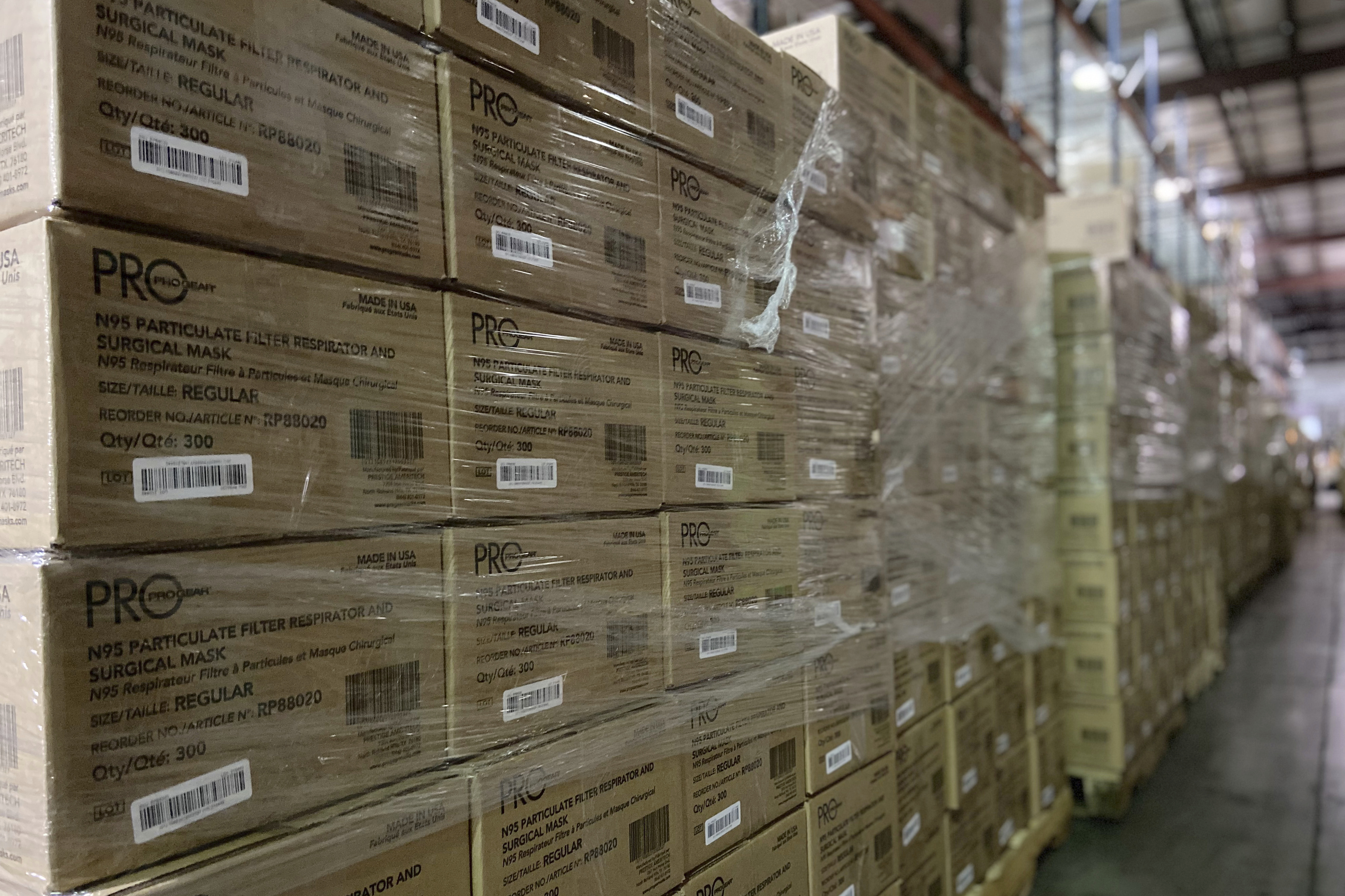 This photo from earlier this month provided by Prestige Ameritech shows boxes of the company's N95 masks in warehouse storage at North Richland Hills, Texas, outside of Fort Worth. One year into the COVID-19 pandemic, the U.S.finds itself with many millions of N95 masks pouring out of American factories and heading into storage. Yet there still aren't nearly enough in ICU rooms and hospitals