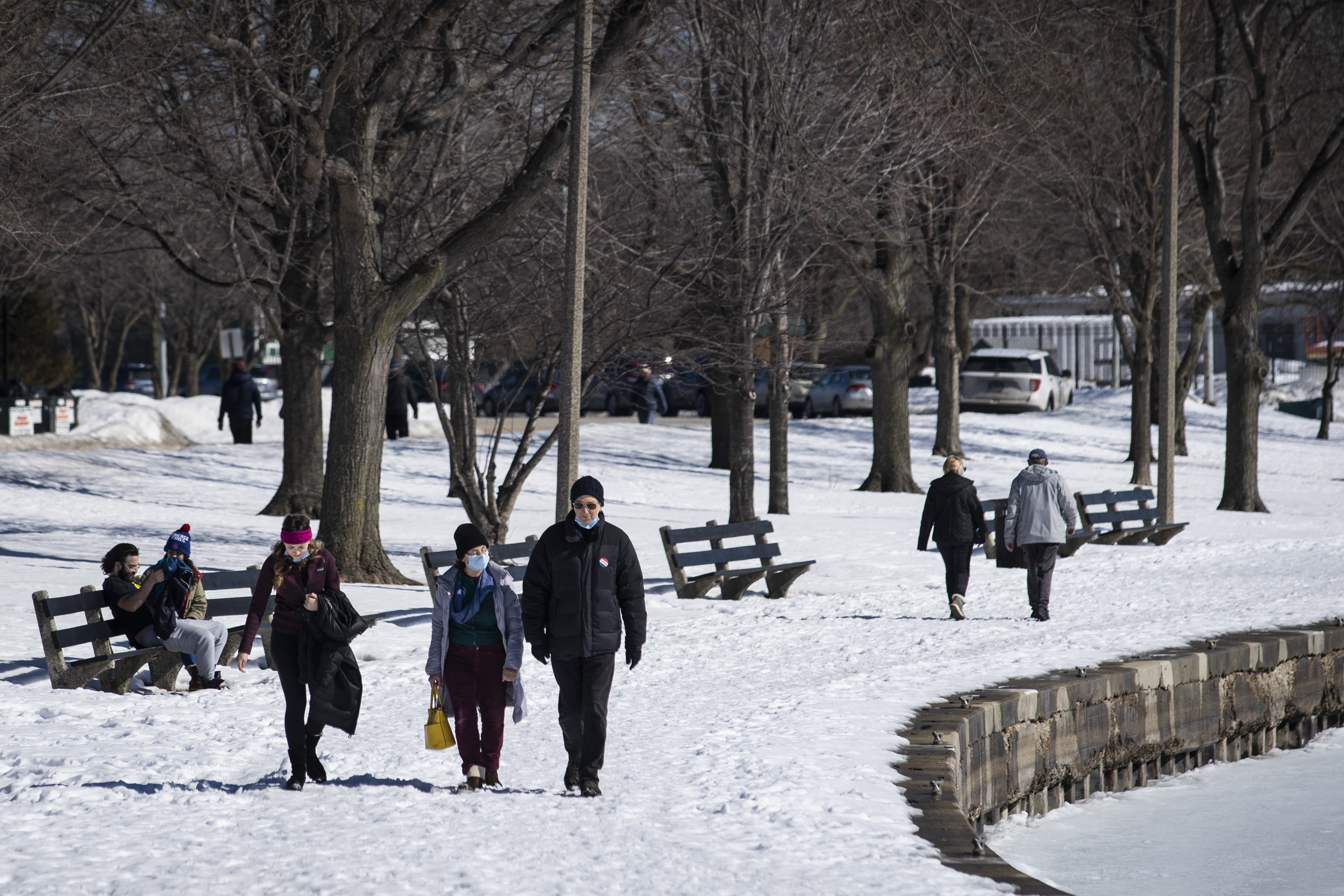 People walk along the lakefront Tuesday afternoon, near a portion West Montrose Avenue east of Lake Shore Drive that had been closed since March amid fears of the coronavirus pandemic.