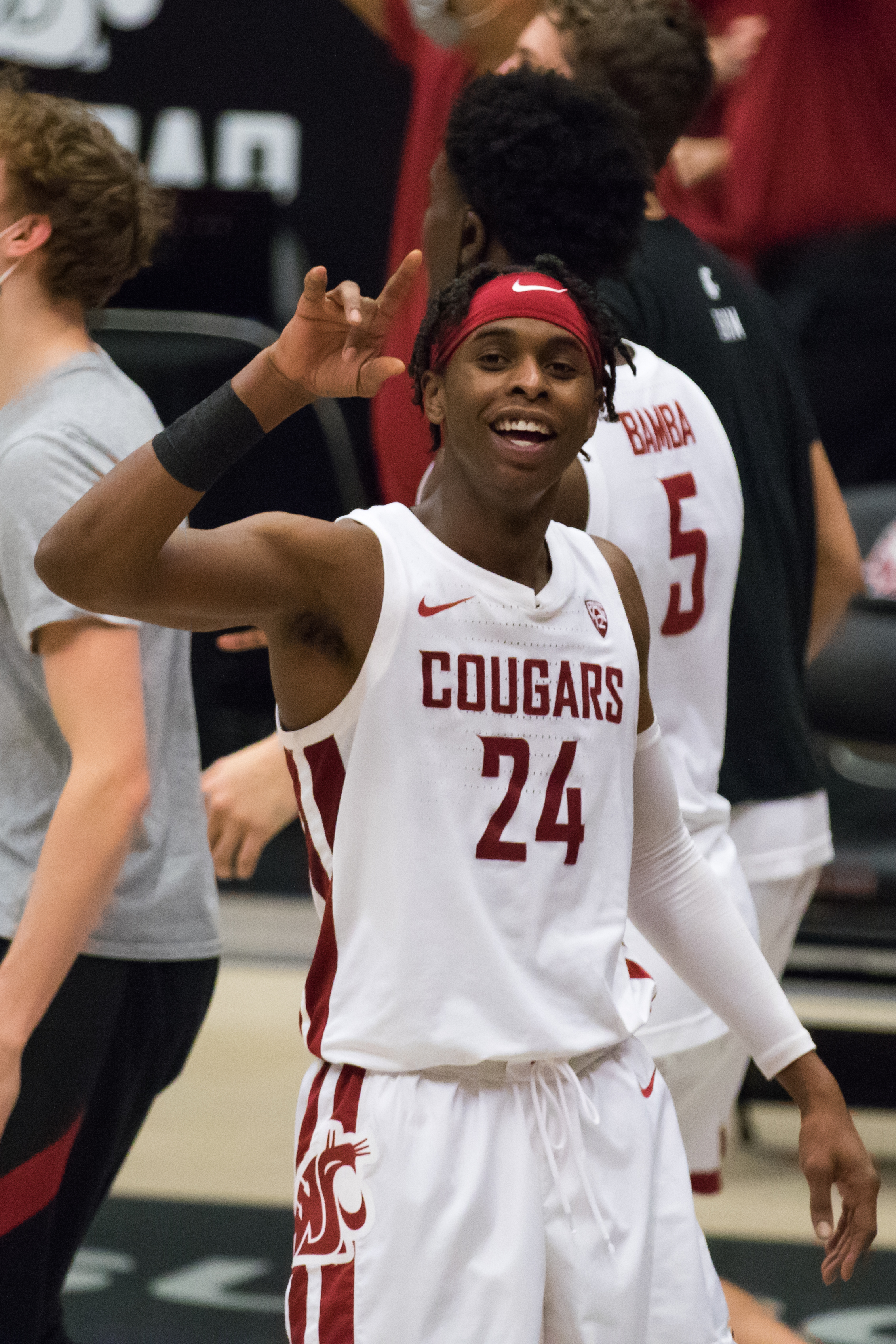 PULLMAN, WA - FEBRUARY 20: Washington State guard Noah Williams (24) hypes up the fans during the third overtime period of a Pac 12 matchup between the Stanford Cardinal and the Washington State Cougars on February 20, 2021, at Beasley Coliseum in Pullman, WA.