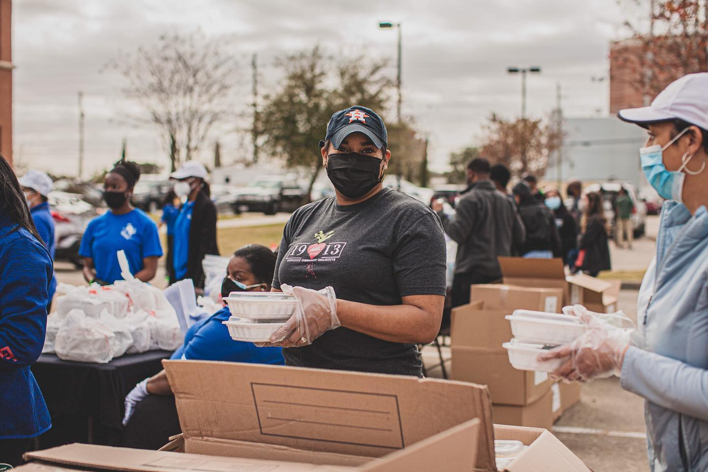People distributing food in the aftermath of Texas winter storms.