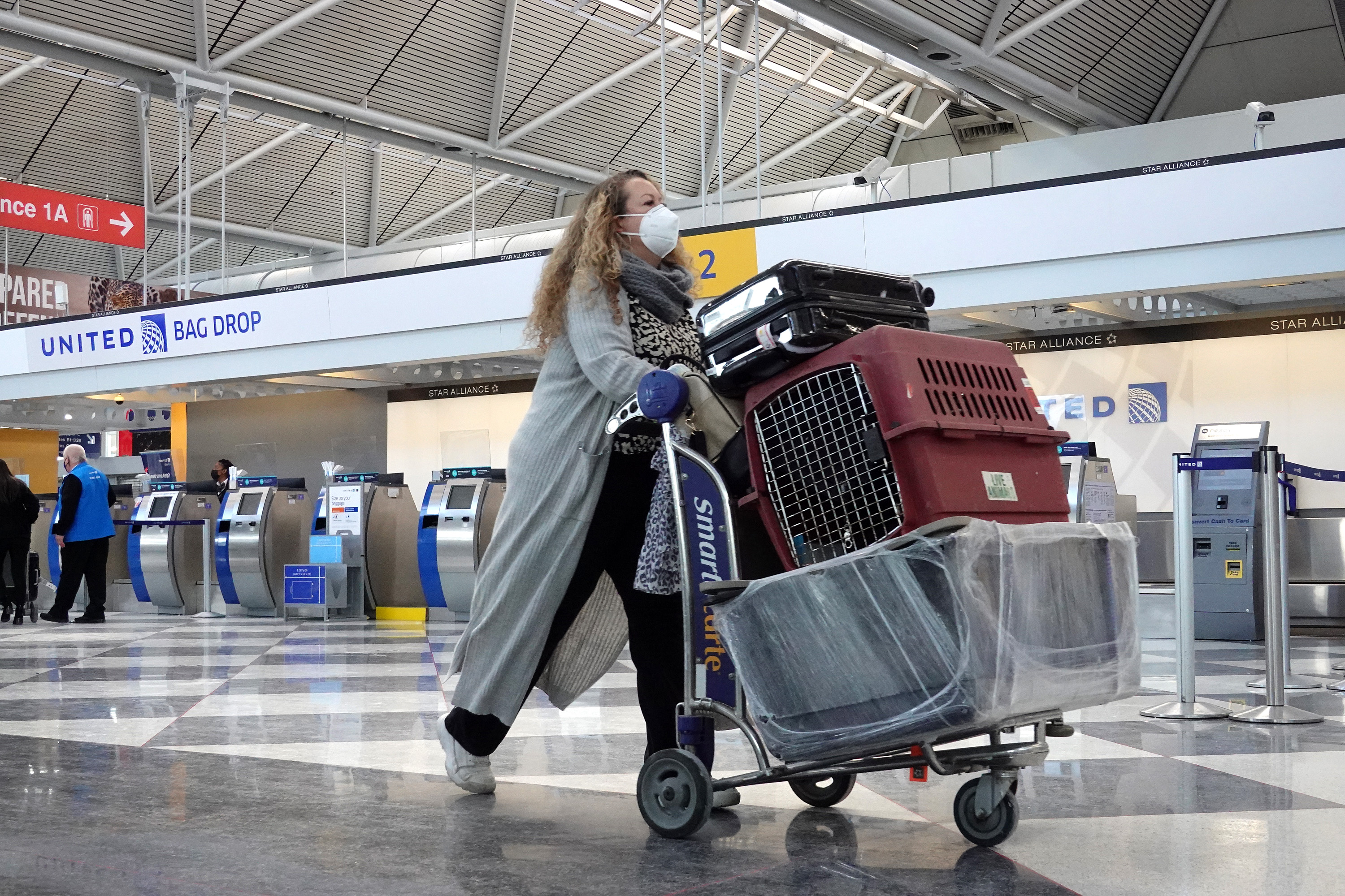 A passenger arrives for a United Airlines flight at O'Hare International Airport earlier this month.
