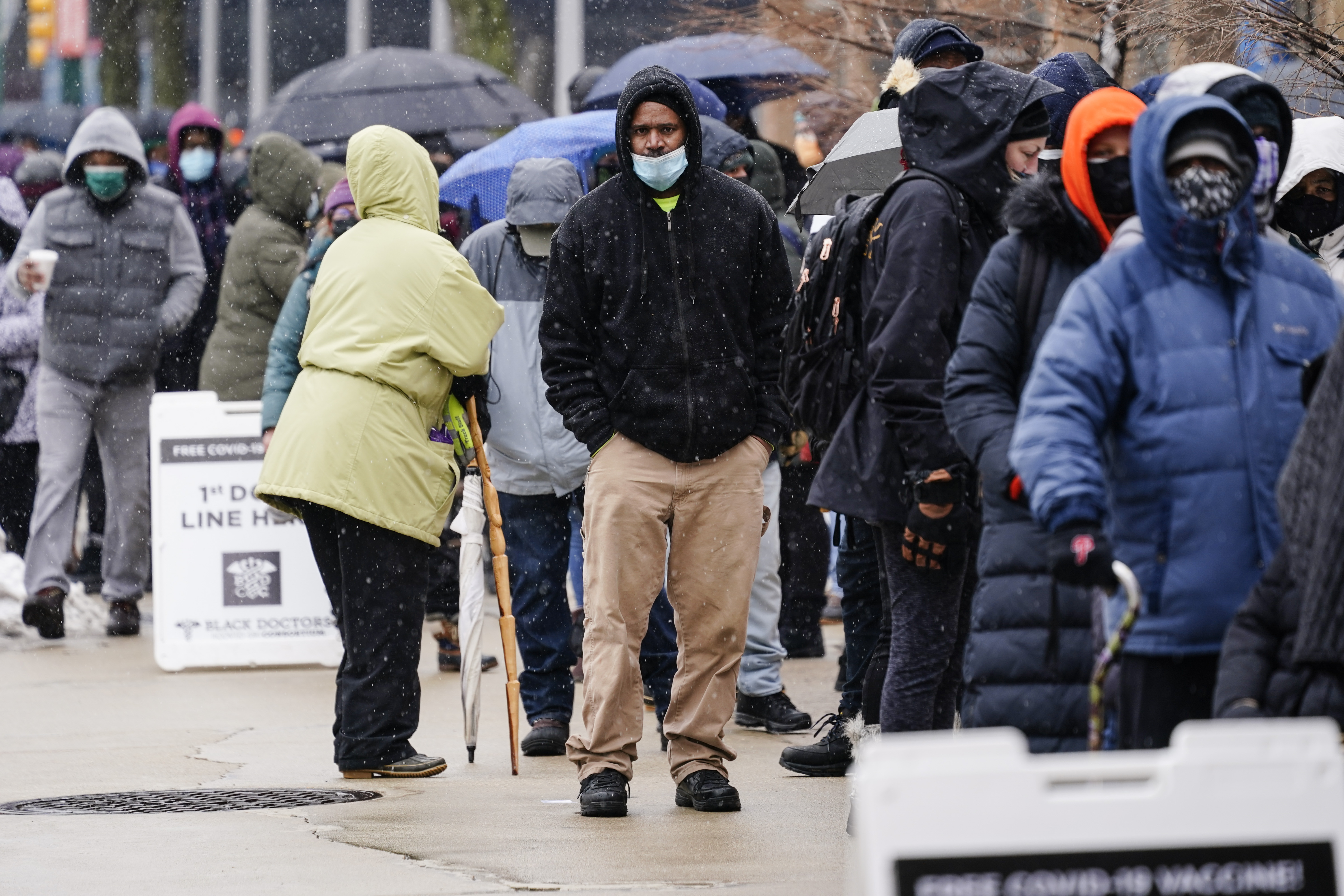 In this Feb. 19, 2021, file photo, people wait in line at a 24-hour, walk-up COVID-19 vaccination clinic hosted by the Black Doctors COVID-19 Consortium at Temple University's Liacouras Center in Philadelphia.