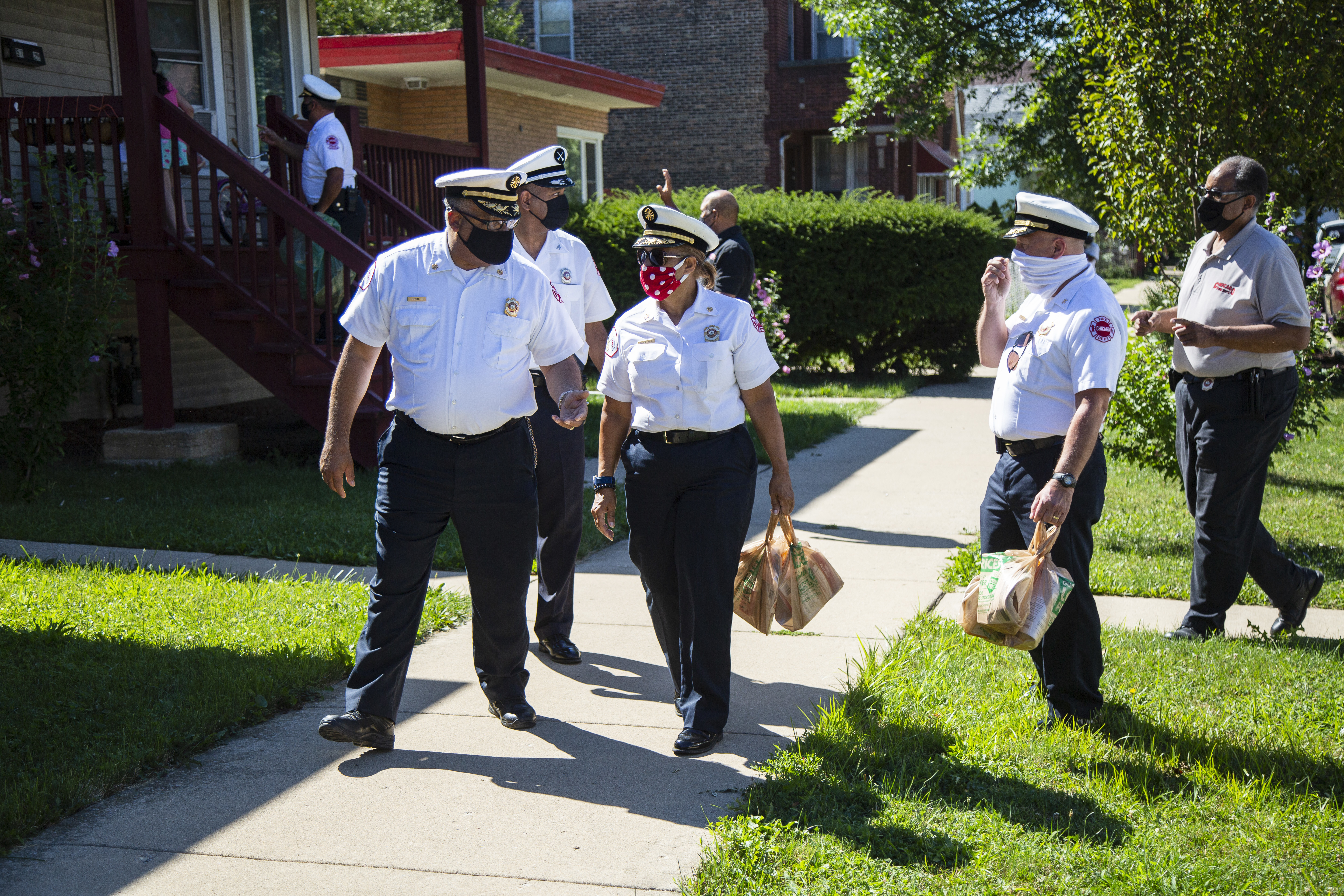 Chicago Fire Department officials handed out smoke detectors on the 5700 block of South Washtenaw Avenue in Gage Park in August 2020 after a fatal fire in the neighborhood.