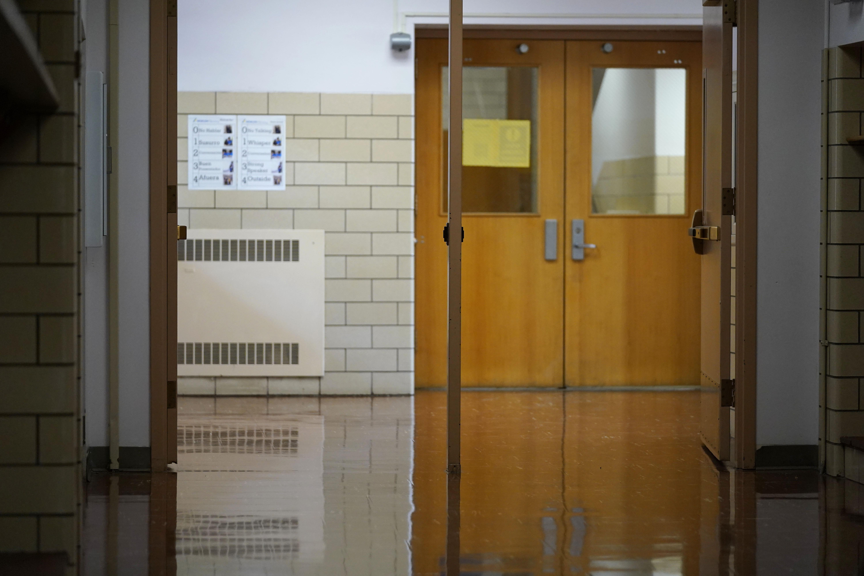 Empty school hallway and door.