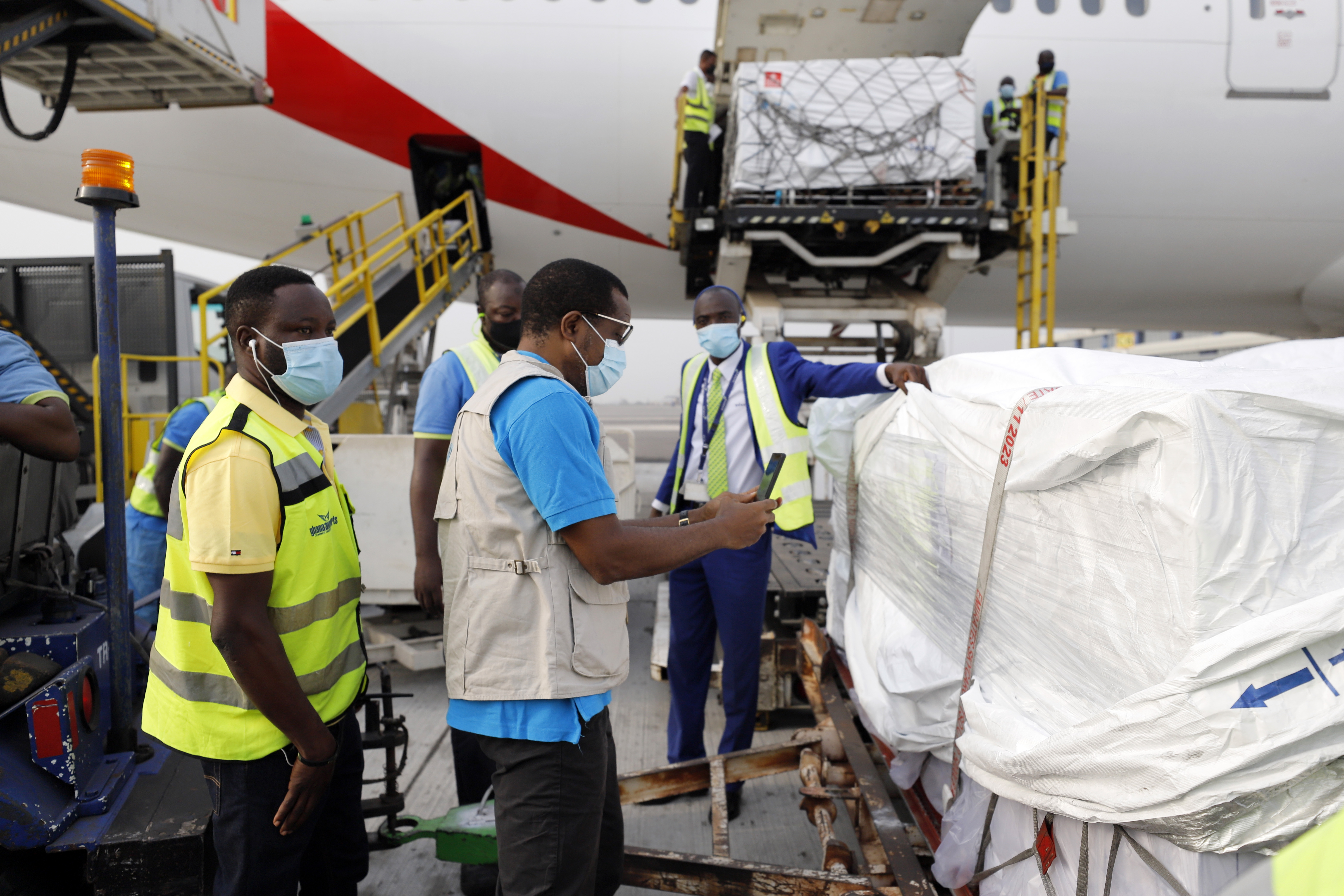 This photograph released by UNICEF Wednesday Feb. 24, 2021, shows the first shipment of COVID-19 vaccines distributed by the COVAX Facility arriving at the Kotoka International Airport in Accra, Ghana.