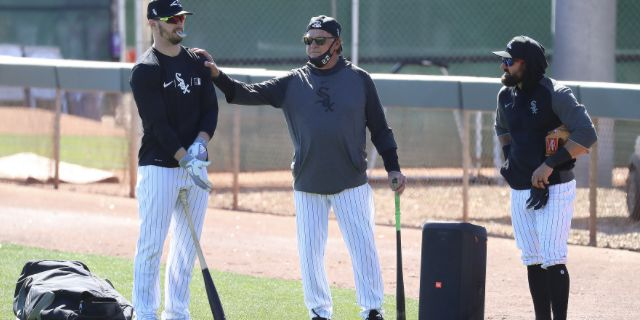 Manager Tony La Russa chats with Adam Engel (left) and Adam Eaton (right) during the White Sox' first full squad workout at Camelback Ranch on Monday.