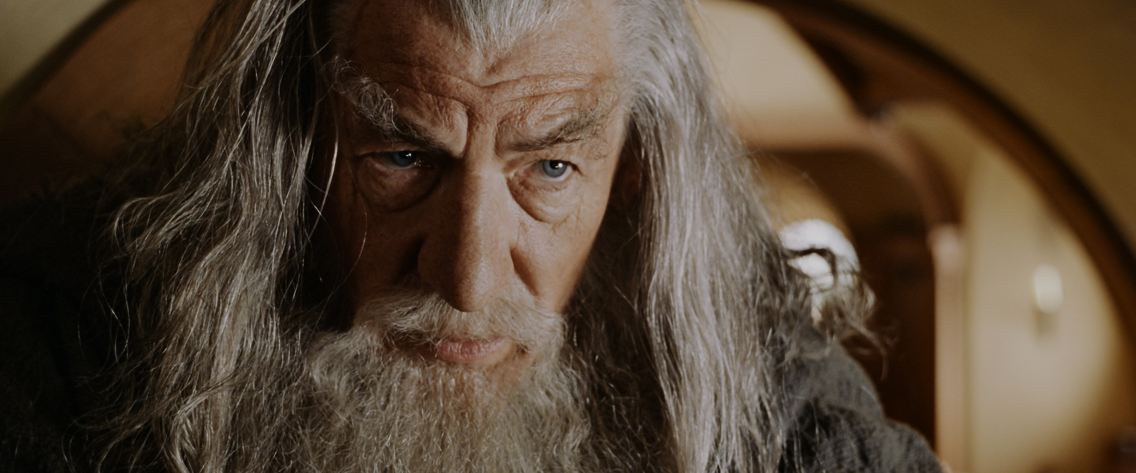 Gandalf in close up in Bilbo's house in the shire in Fellowship of the Ring Lord of the Rings