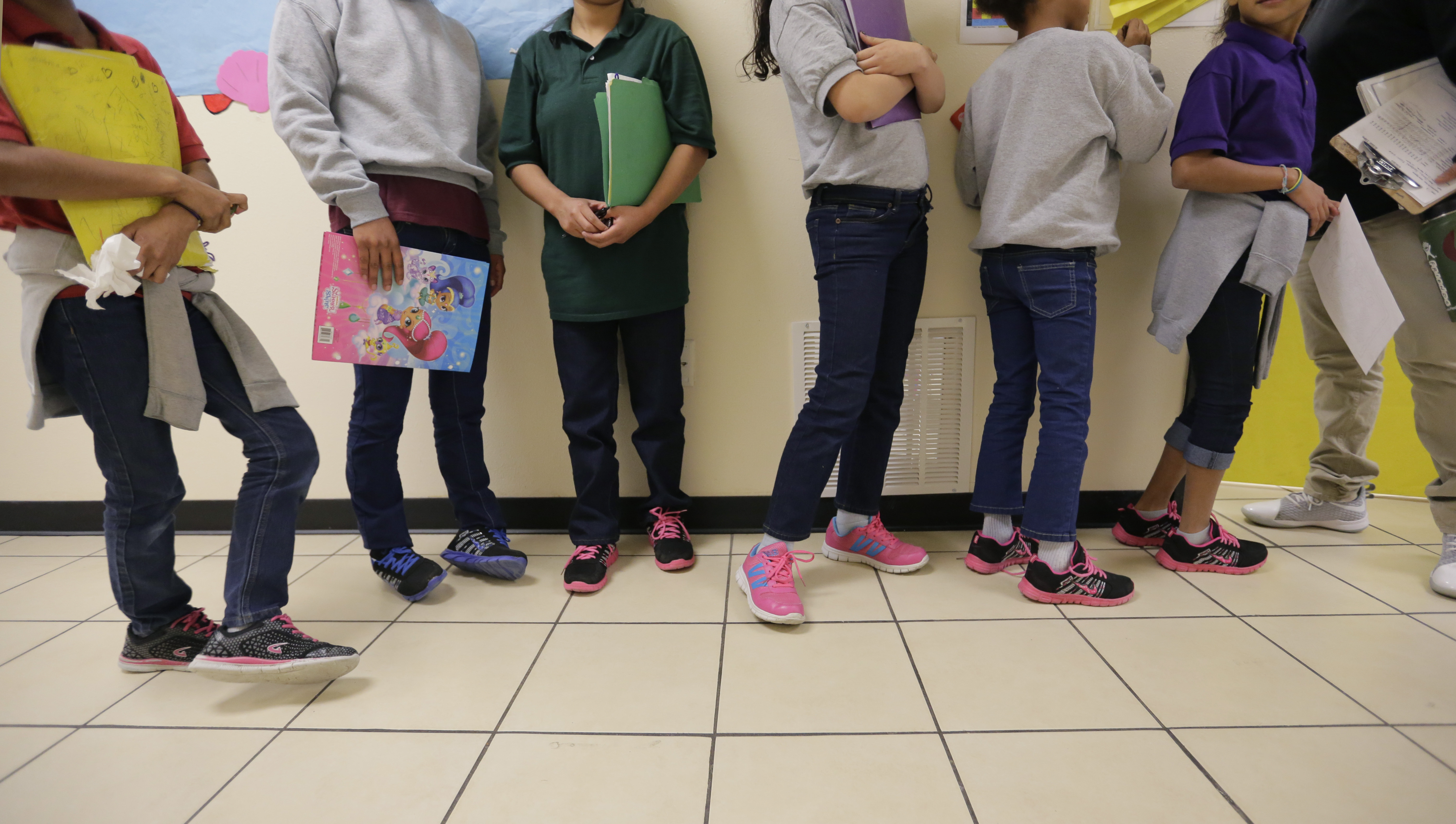 """In this Aug. 29, 2019, file photo, migrant teens line up for a class at a """"tender-age"""" facility for babies, children and teens, in Texas' Rio Grande Valley, in San Benito, Texas."""