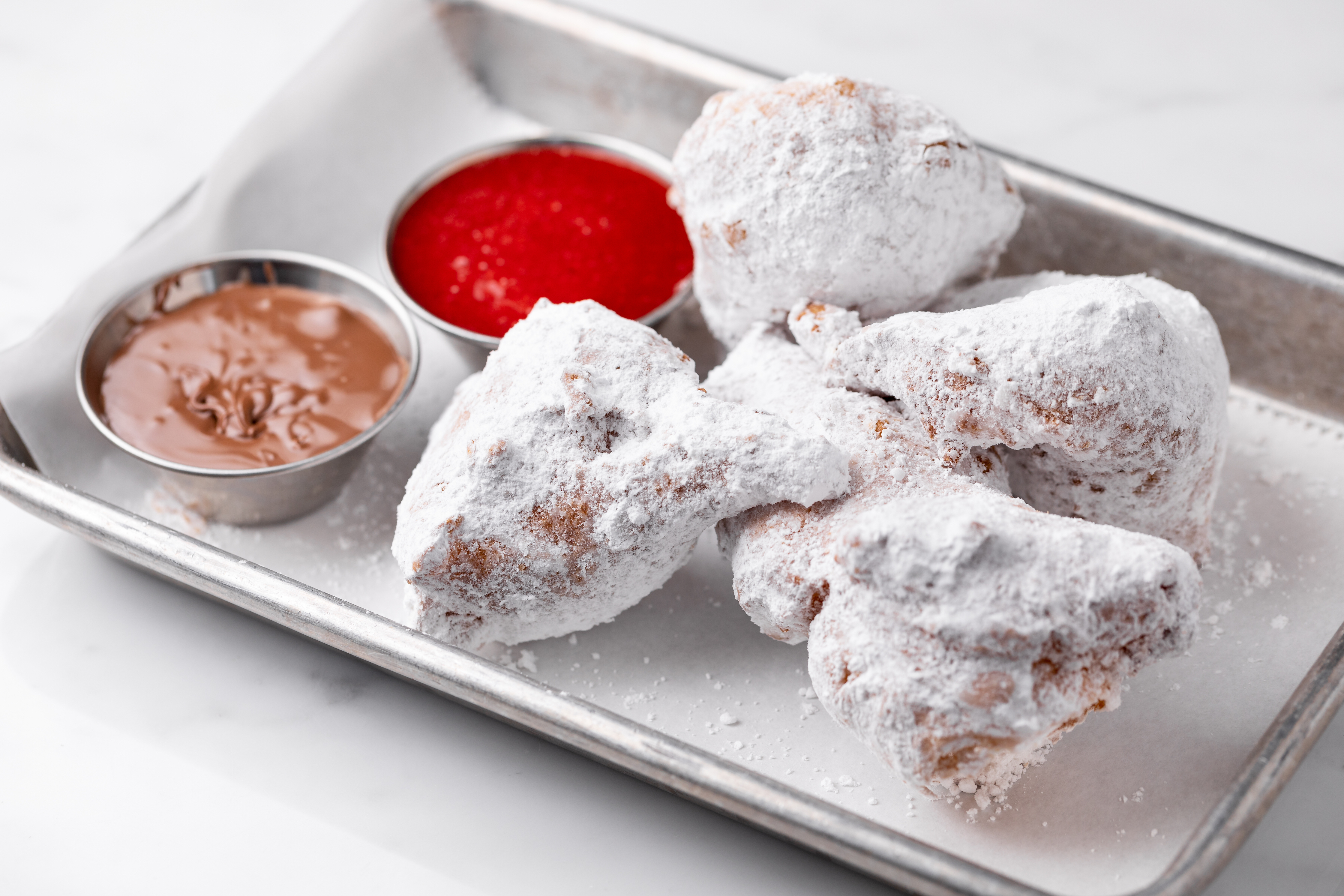 Hilltop Coffee + Kitchen's beignets with Nutella and berry dipping sauces in Eagle Rock, California