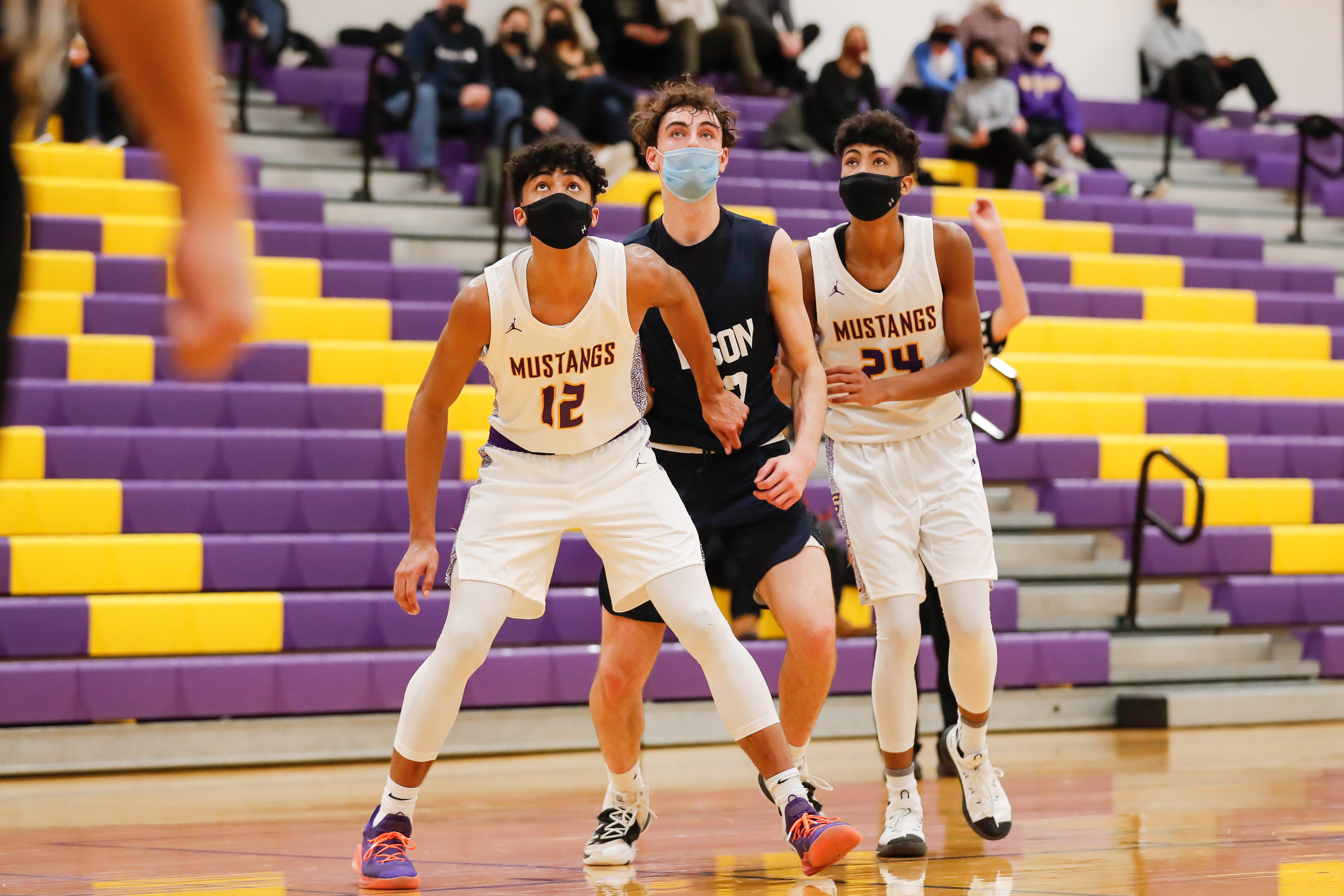 Rolling Meadows' Max Christie (12) and Cameron Christie (24) cover Buffalo Groves' Kam Craft (12).