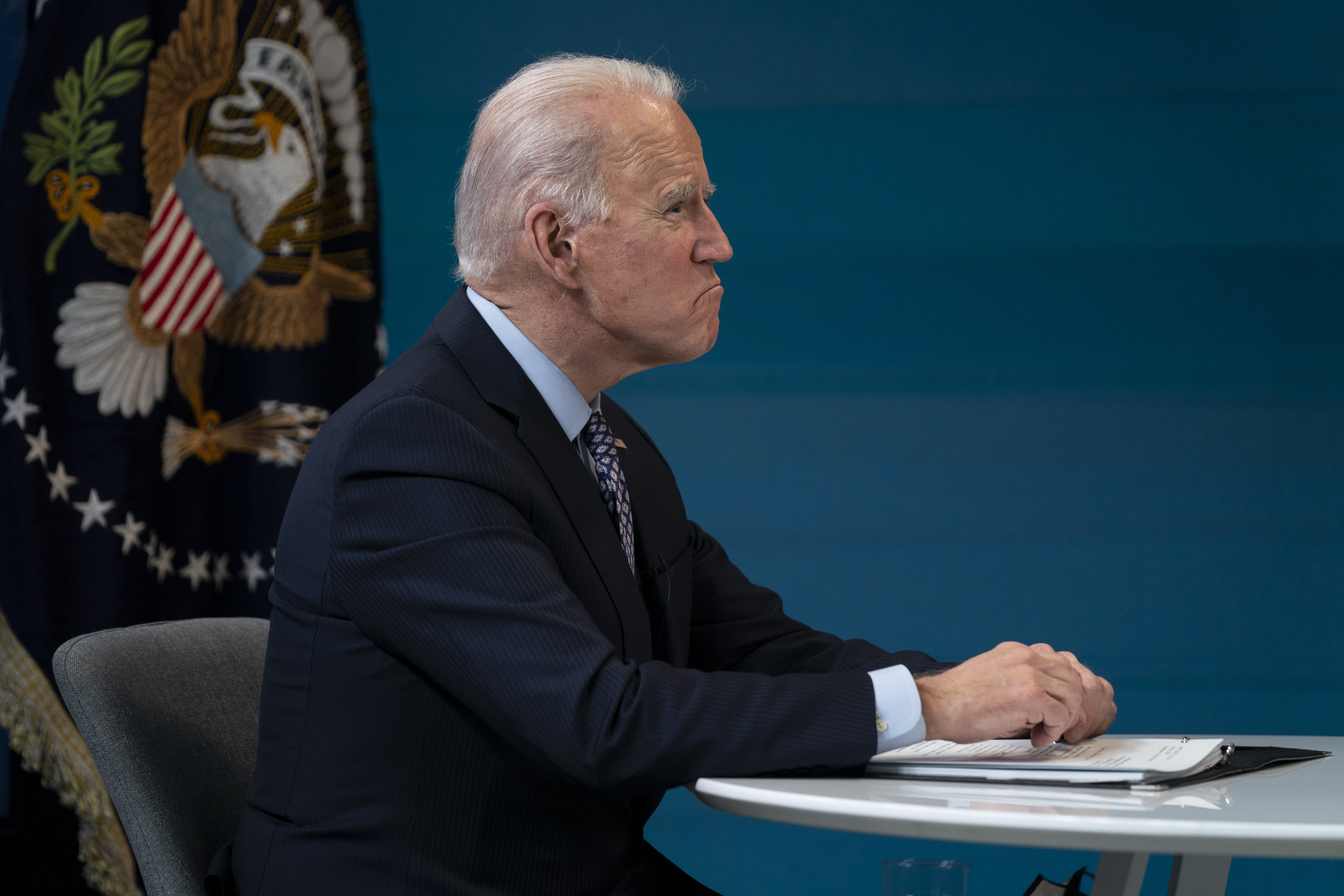 President Joe Biden prepares to speak to a virtual meeting of the National Governors Association, in the South Court Auditorium on the White House campus, Thursday, Feb. 25, 2021, in Washington.