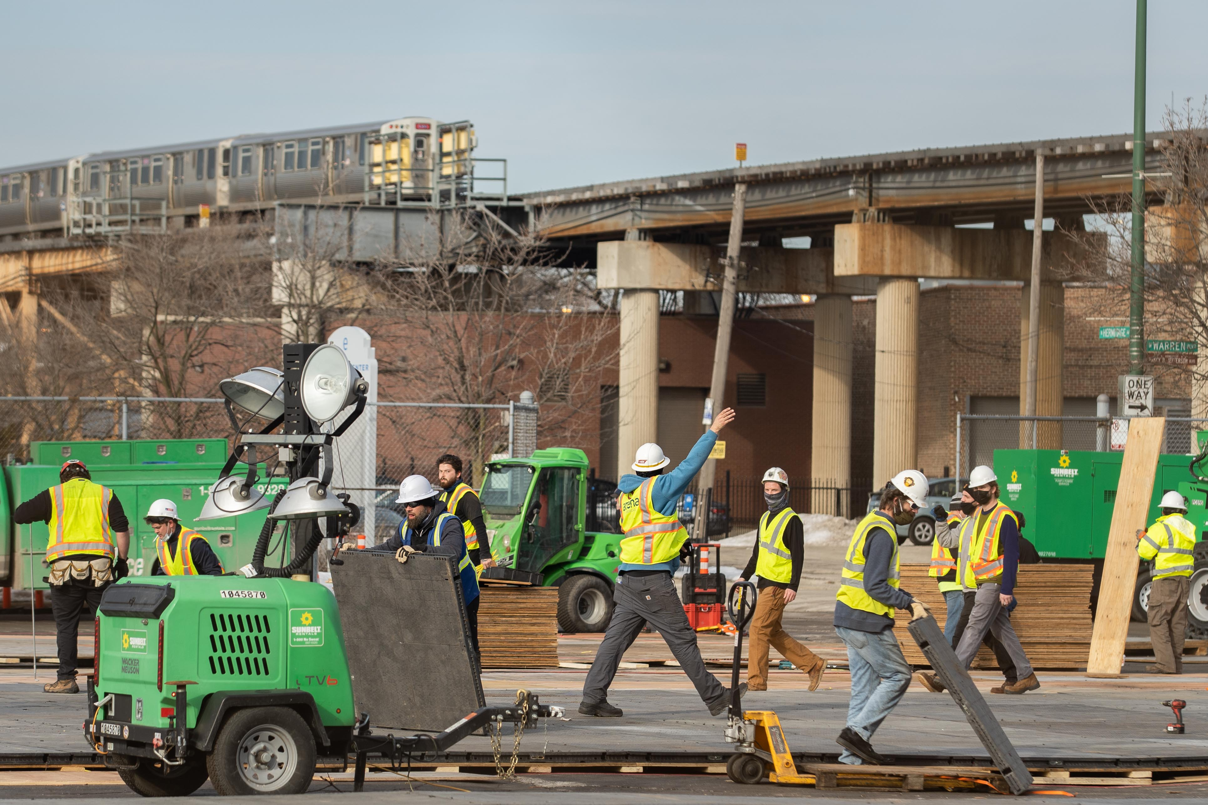 Crews construct a new mass COVID-19 vaccination site on one of United Center's parking lots in the Near West Side neighborhood, Friday afternoon, Feb. 26, 2021.