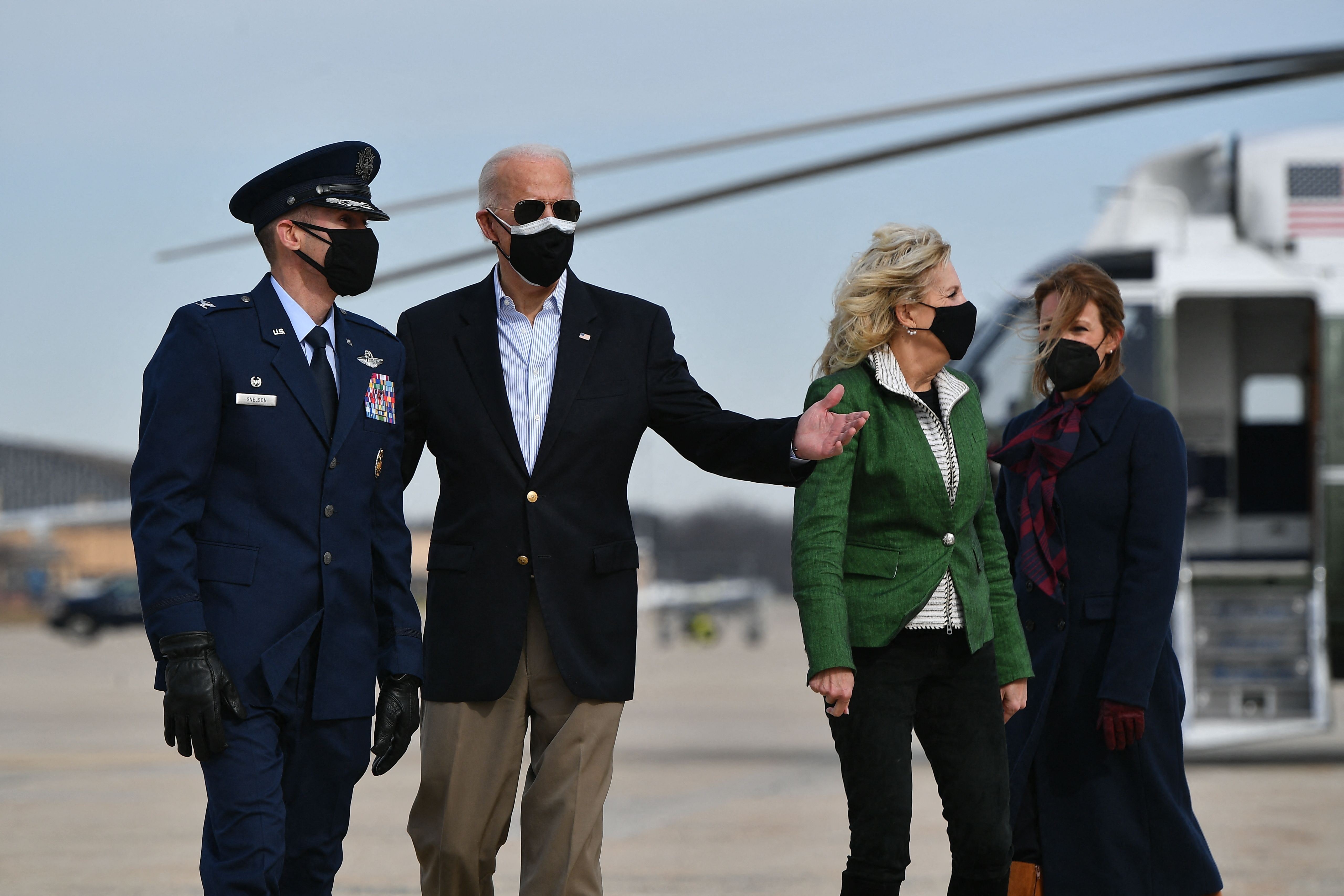 US President Joe Biden and First Lady Jill Biden are greeted by Colonel Stephen P. Snelson (L) and his wife, Catherine Snelson, as the Bidens arrive to board Air Force One at Joint Base Andrews in Maryland on February 26, 2021.