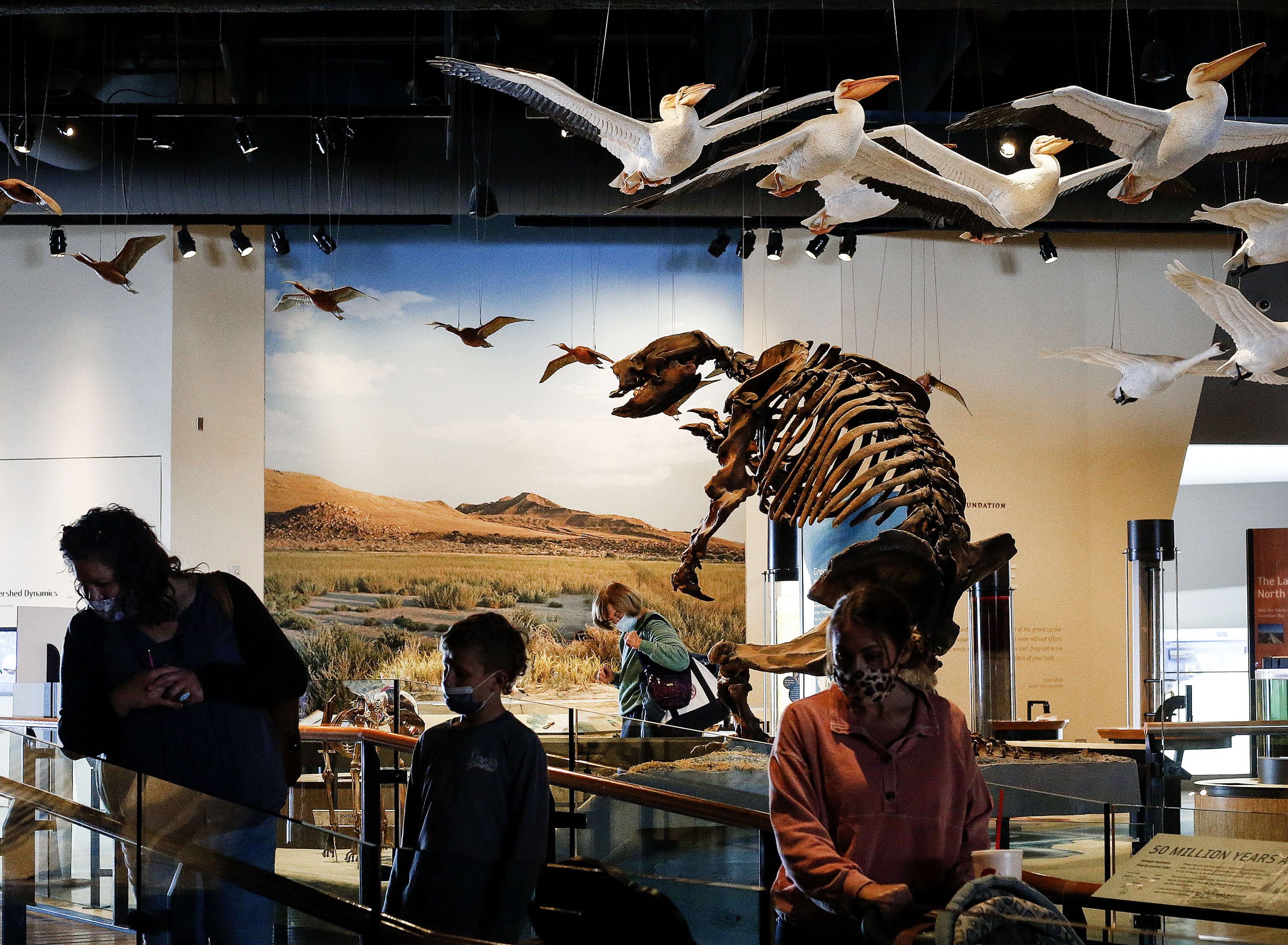 People tour the Natural History Museum of Utah in Salt Lake City on Friday, Feb. 19, 2021.