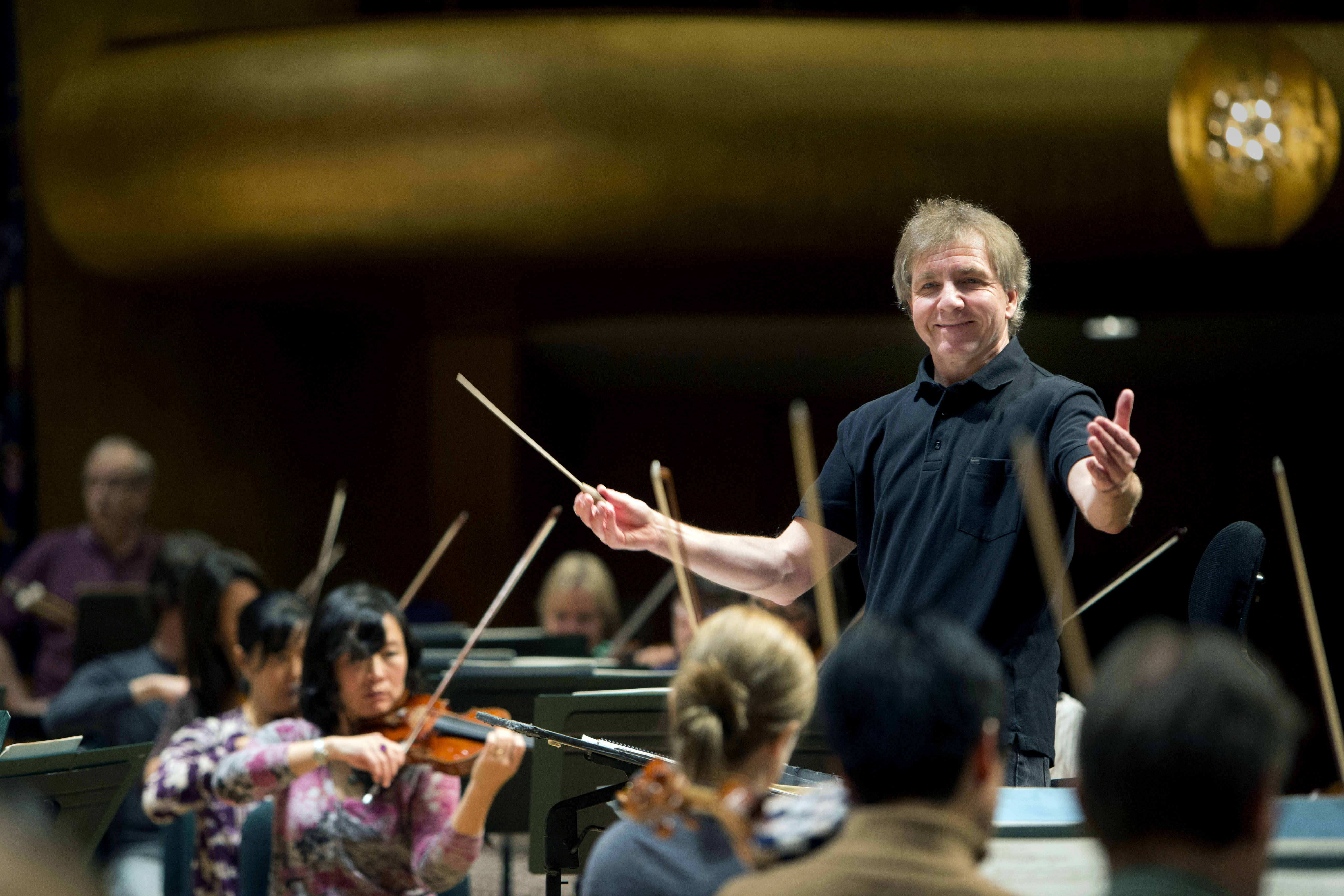 Thierry Fischer, music director of the Utah Symphony, conducts a practice with the symphony at Abravanel Hall in Salt Lake City on Wednesday, Nov. 20, 2013. After being shut down due to COVID-19, Abravanel Hall is reopening to the public on March 25.