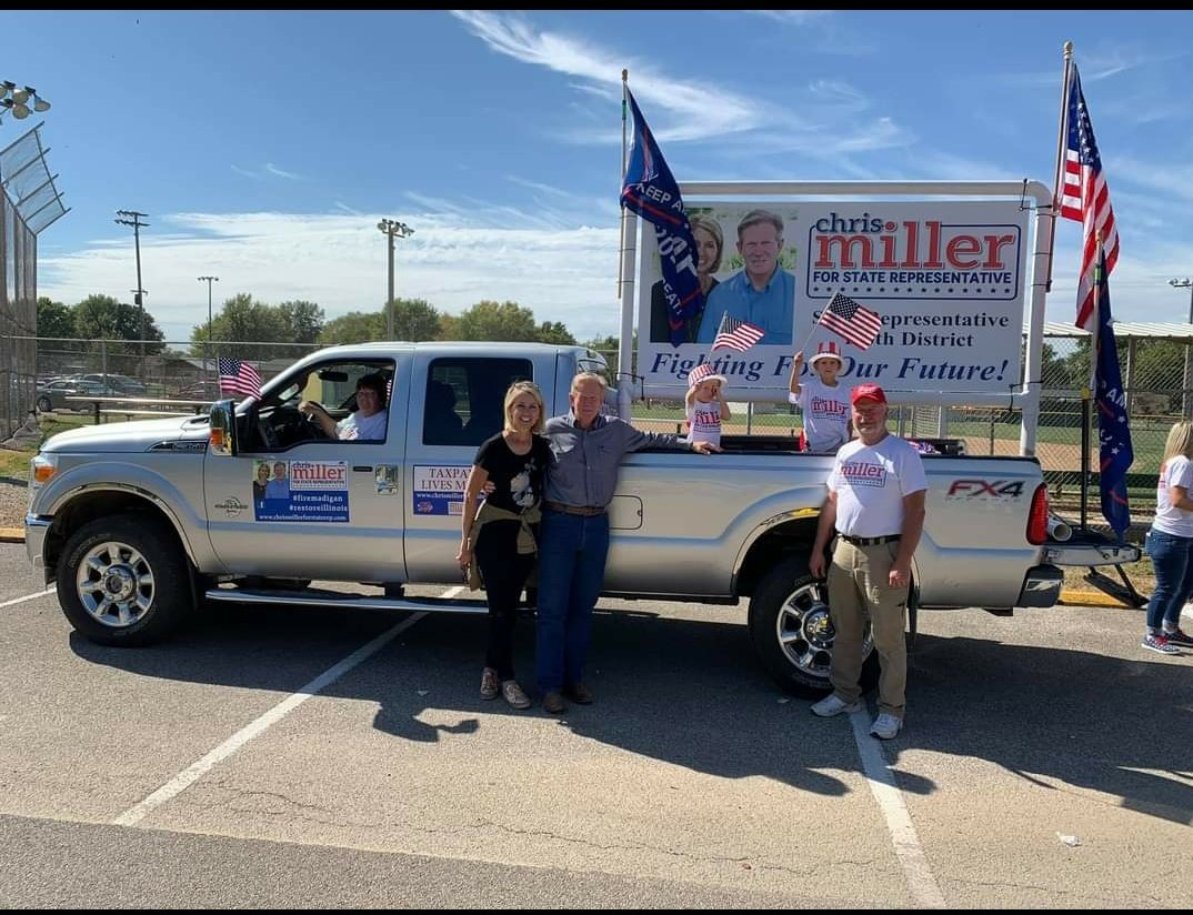 U.S. Rep Mary Miller and her husband, state Rep. Chris Miller, center, pose next to their pick-up truck in a campaign photo.
