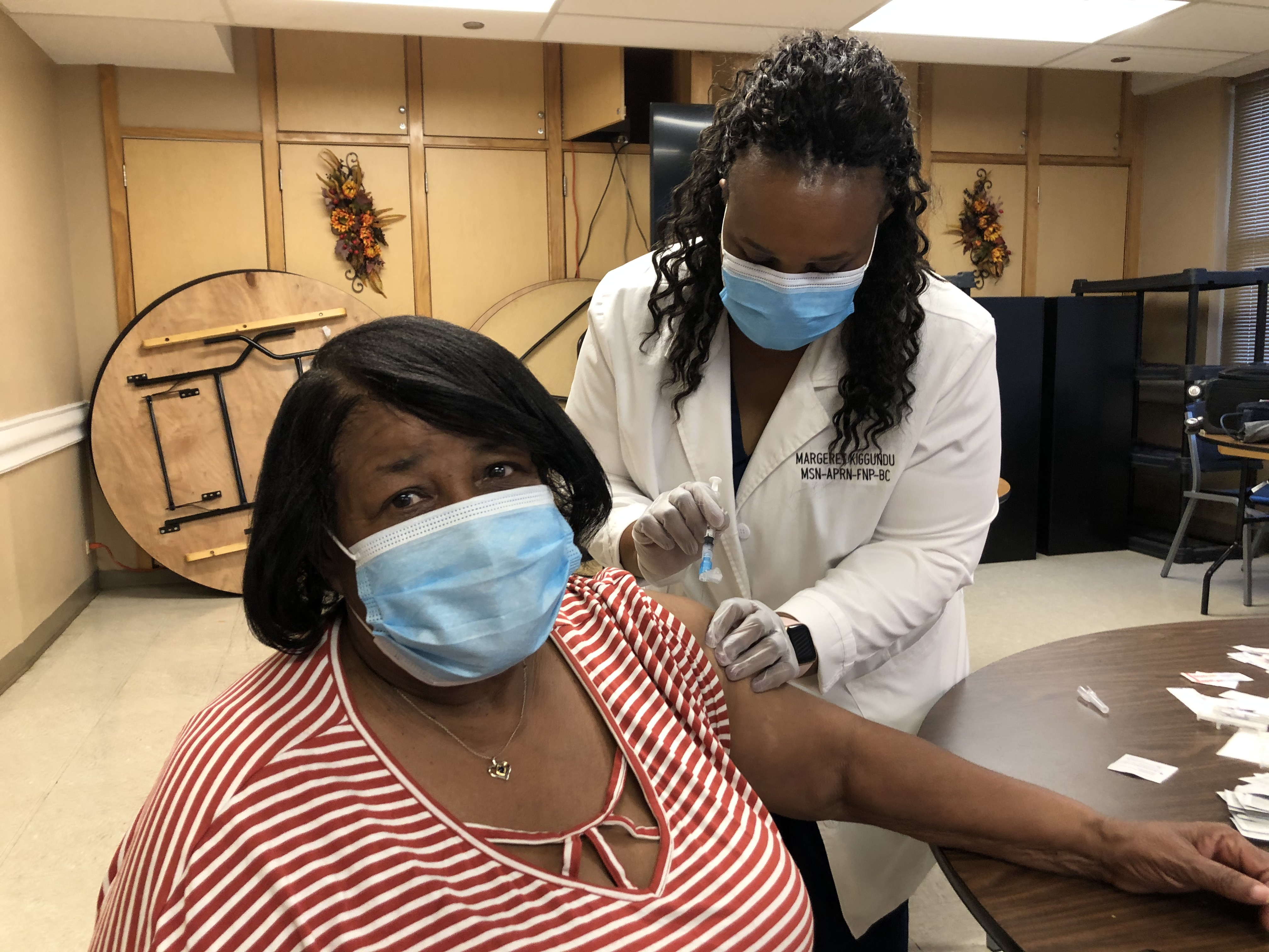 A worried Yvonne Johnson braces for her vaccination at the CHA's Alfreda Burnett Duster Apartments, where COVID-19 shots were being administered as part of the city of Chicago's senior outreach efforts.