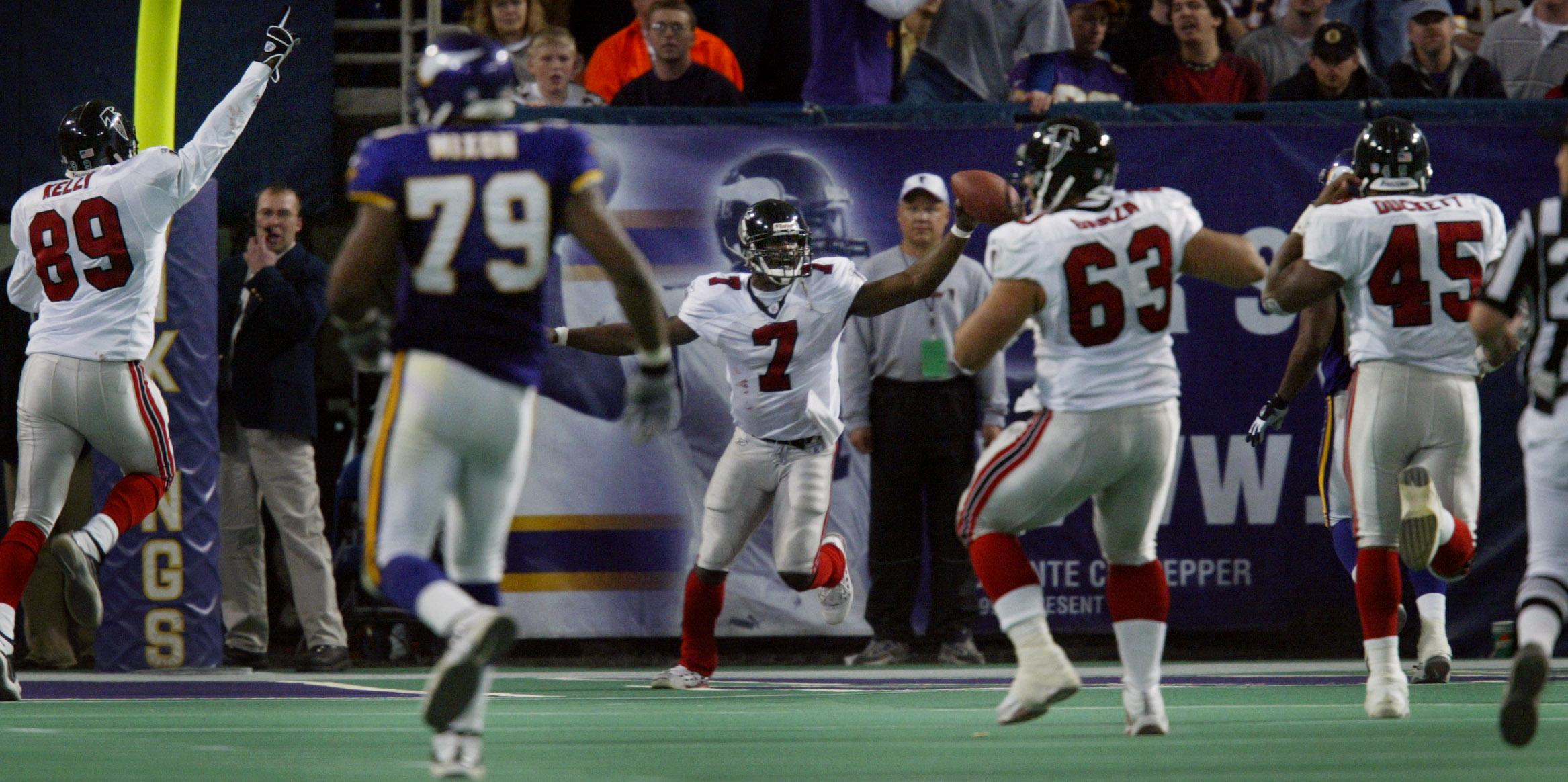 Minneapolis MN, 12/1/02 Vikings vs Atlanta-----Atlanta Falcons star quarterback Michael Vick celebrates his winning touchdown run in overtime over the Vikings Sunday at the dome.