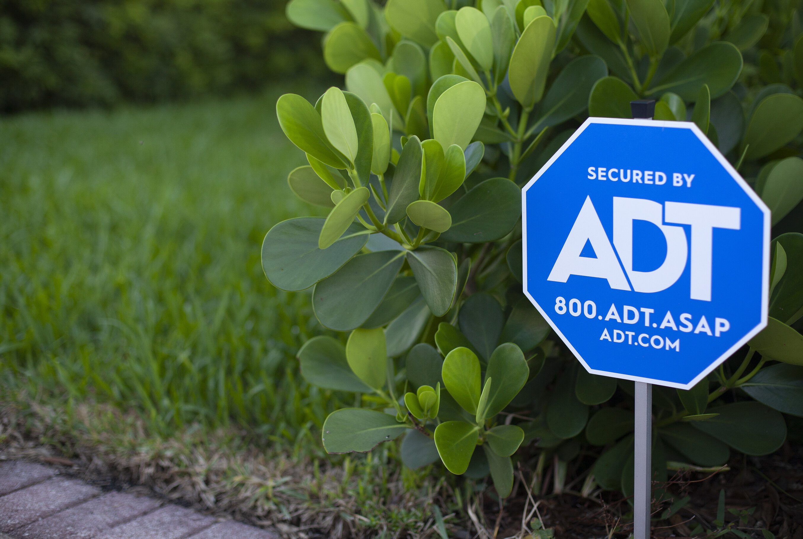 Close-up of an ADT sign outside