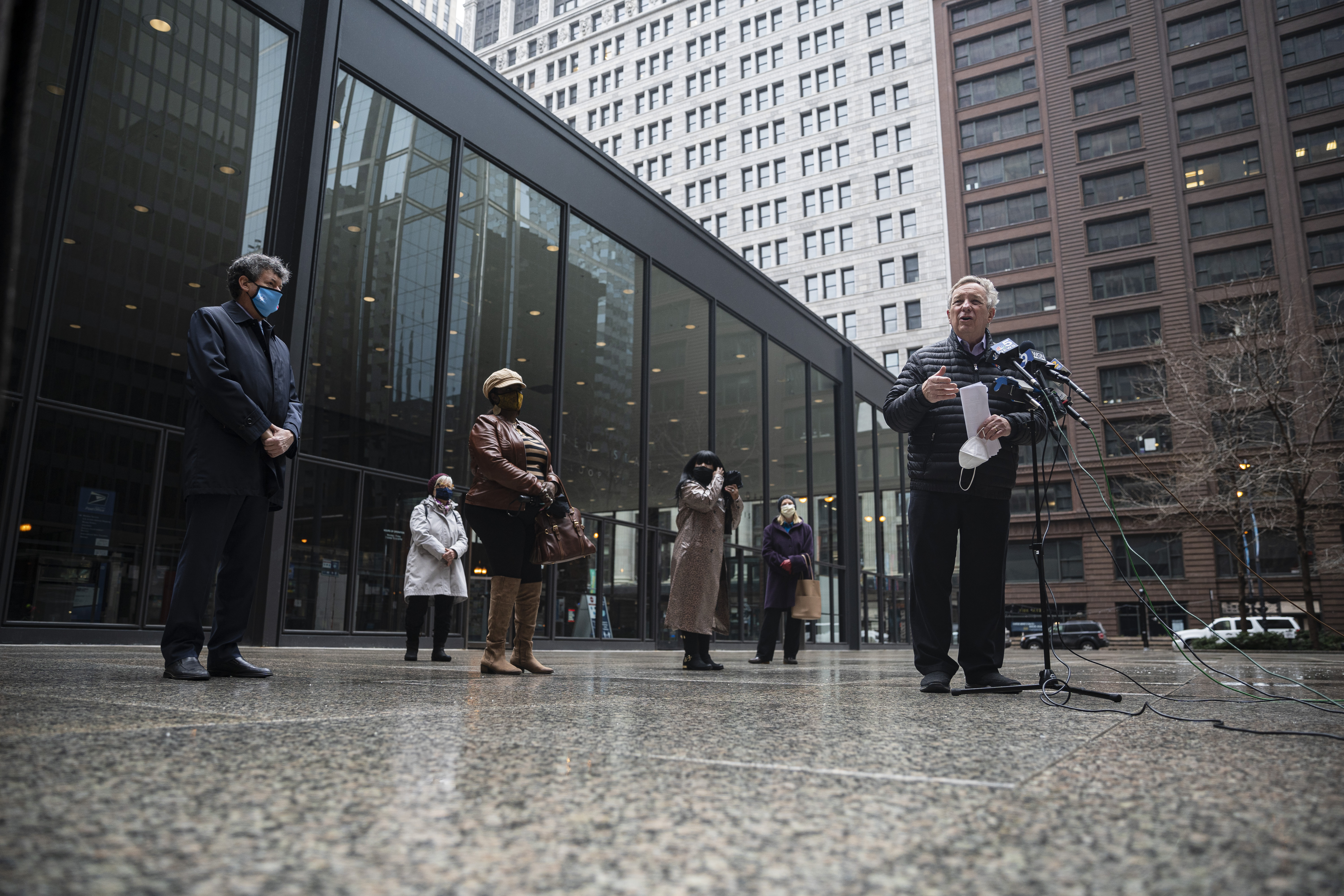 Sen. Dick Durbin urges the Trump-appointed postmaster, Louis DeJoy, to step down during a news conference Sunday, Feb. 28, 2021, at Federal Plaza in the Loop.