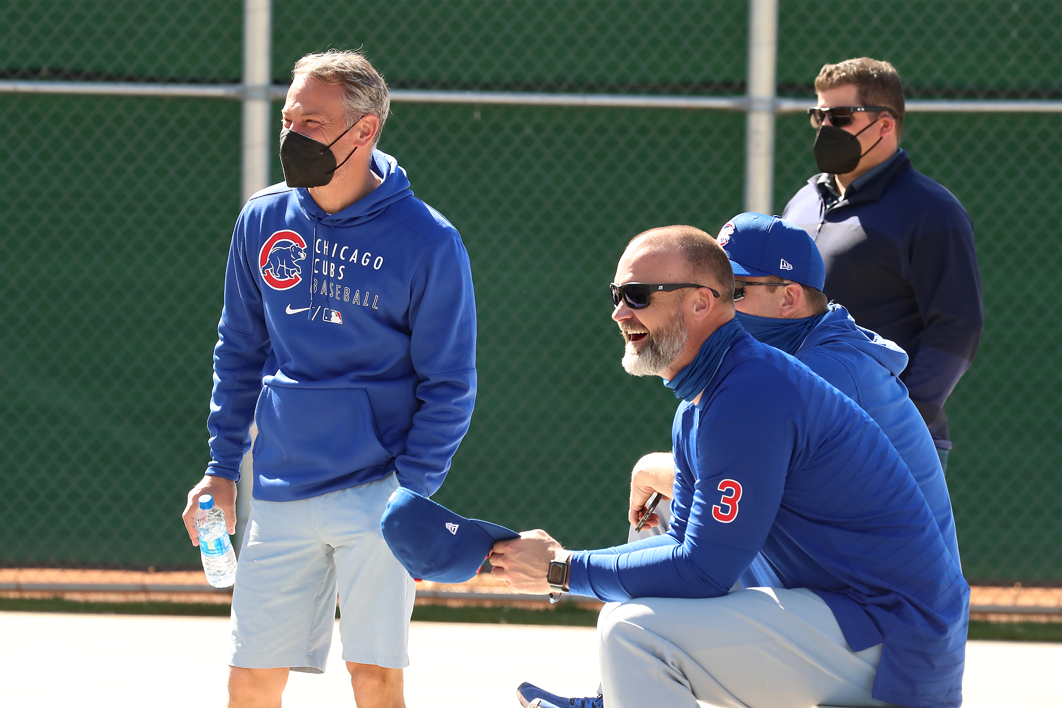Cubs president Jed Hoyer and manager David Ross watch a spring training practice session.