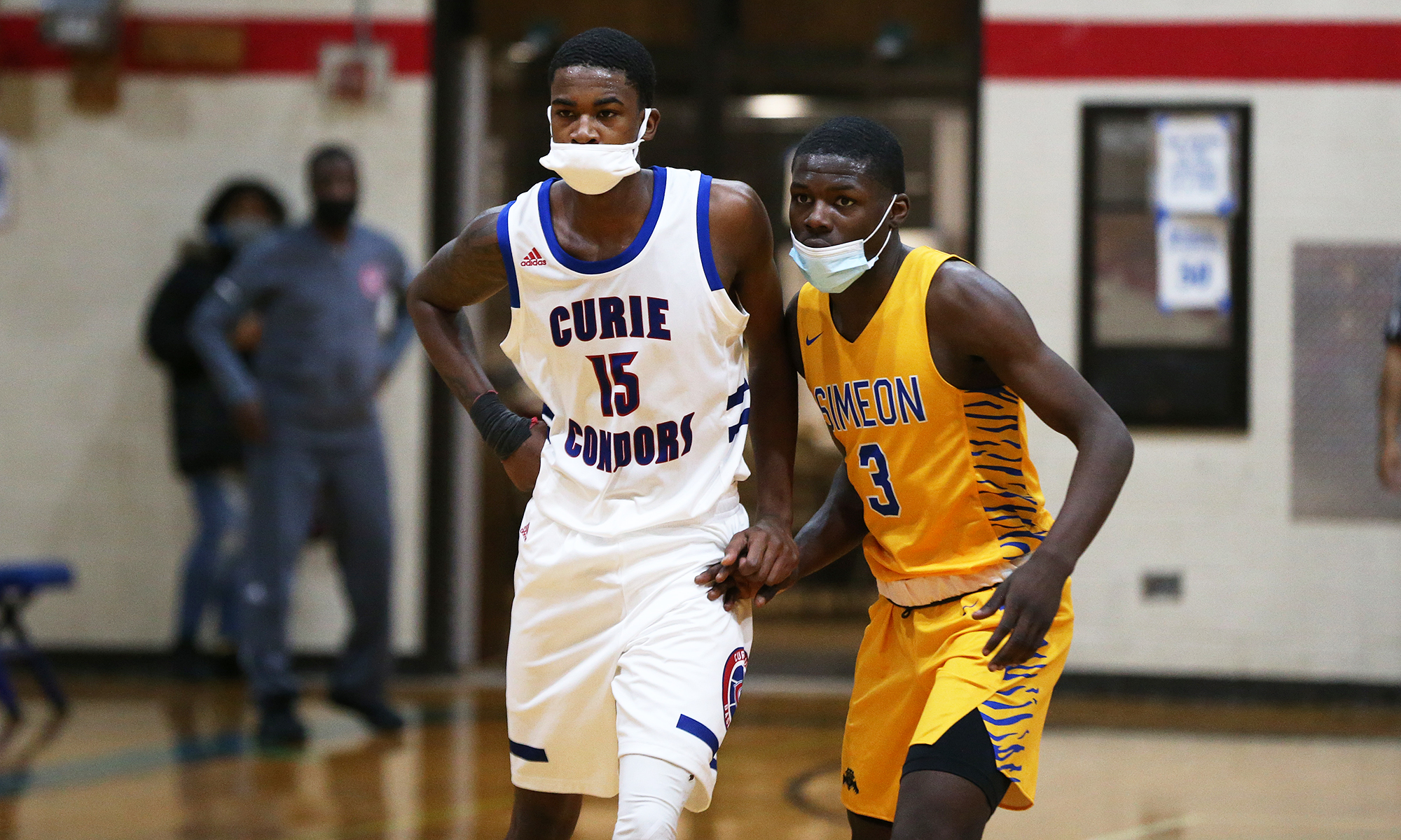 Simeon's Ahamad Bynum (3) and Curie's Phillip Berryhill (15) get ready for an inbounds play.