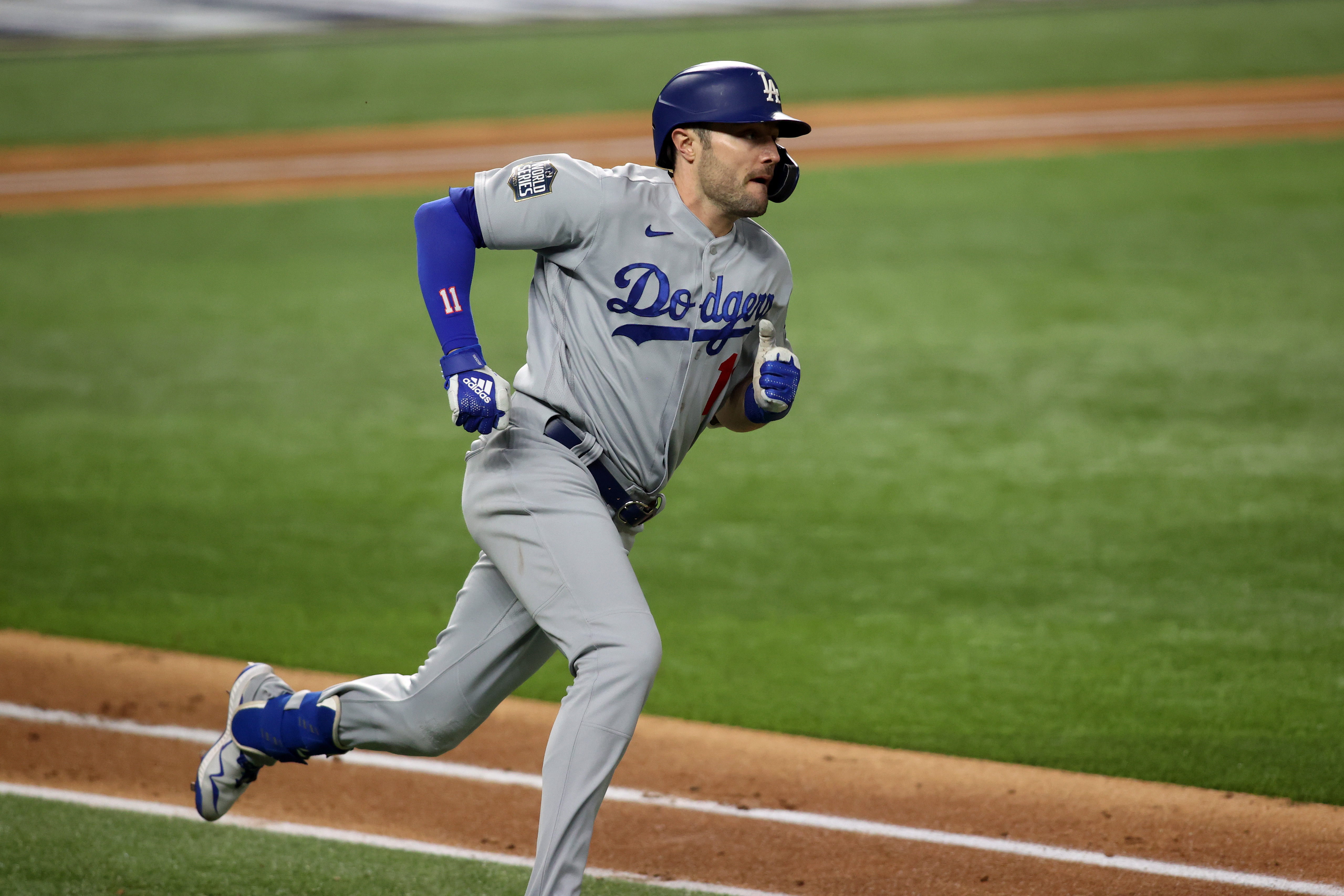 Los Angeles Dodgers center fielder A.J. Pollock runs after hitting a double against the Tampa Bay Rays during the fourth inning of game four of the 2020 World Series at Globe Life Field.