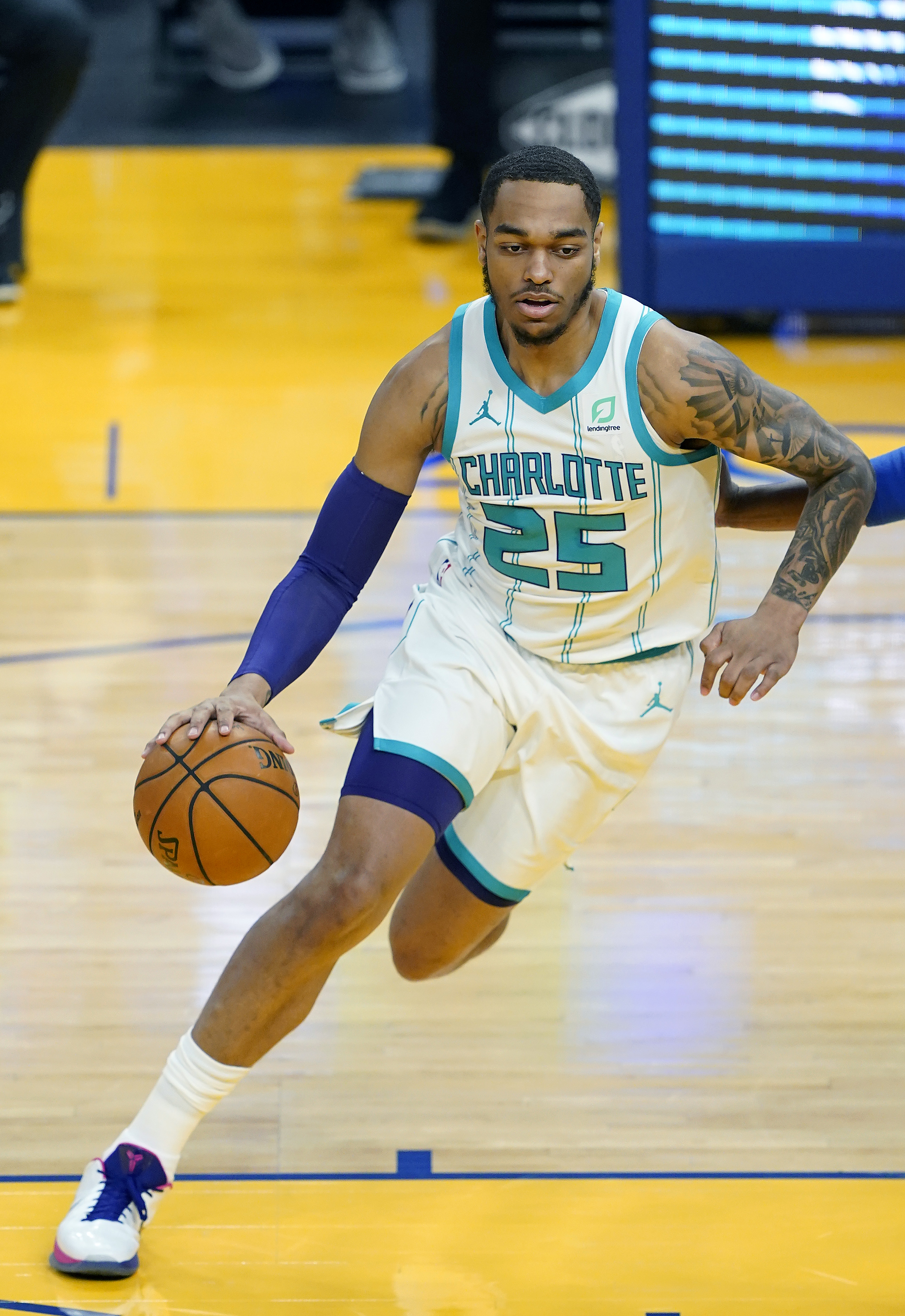 P.J. Washington of the Charlotte Hornets dribbles the ball across the key against the Golden State Warriors during the first half of an NBA basketball game at Chase Center on February 26, 2021 in San Francisco, California.