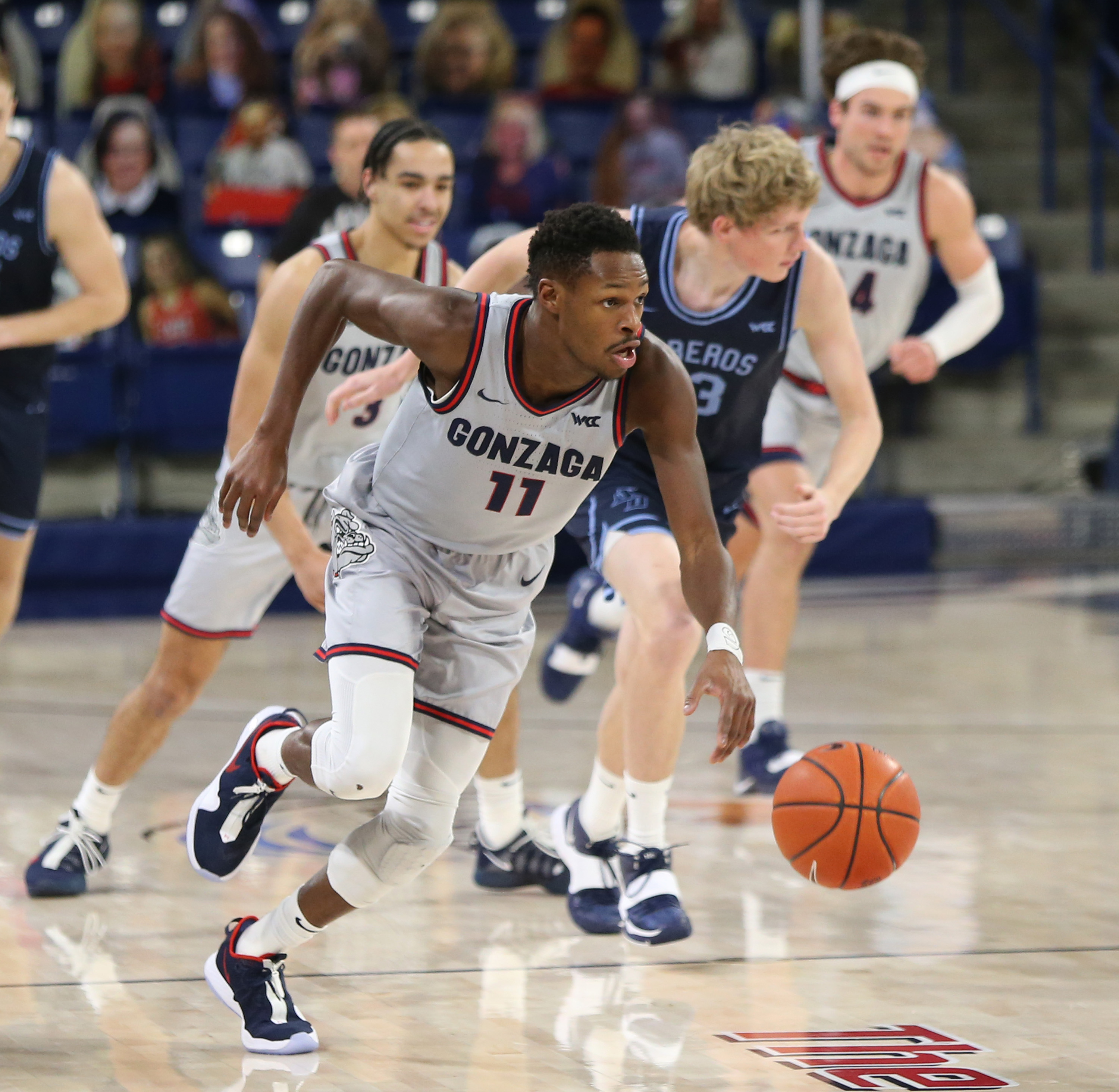Joel Ayayi #11 of the Gonzaga Bulldogs drives the ball against the San Diego Toreros in the game at McCarthey Athletic Center on February 20, 2021 in Spokane, Washington.