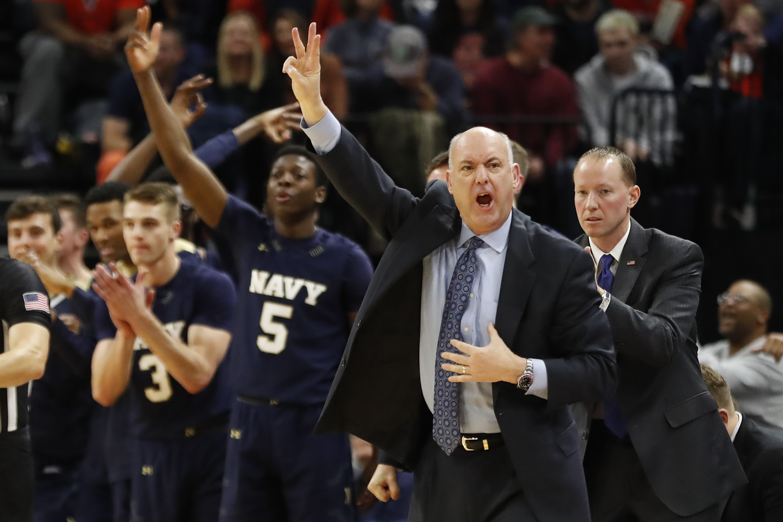 Navy Midshipmen head coach Ed DeChellis gestures from the bench against the Virginia Cavaliers in the second half at John Paul Jones Arena.
