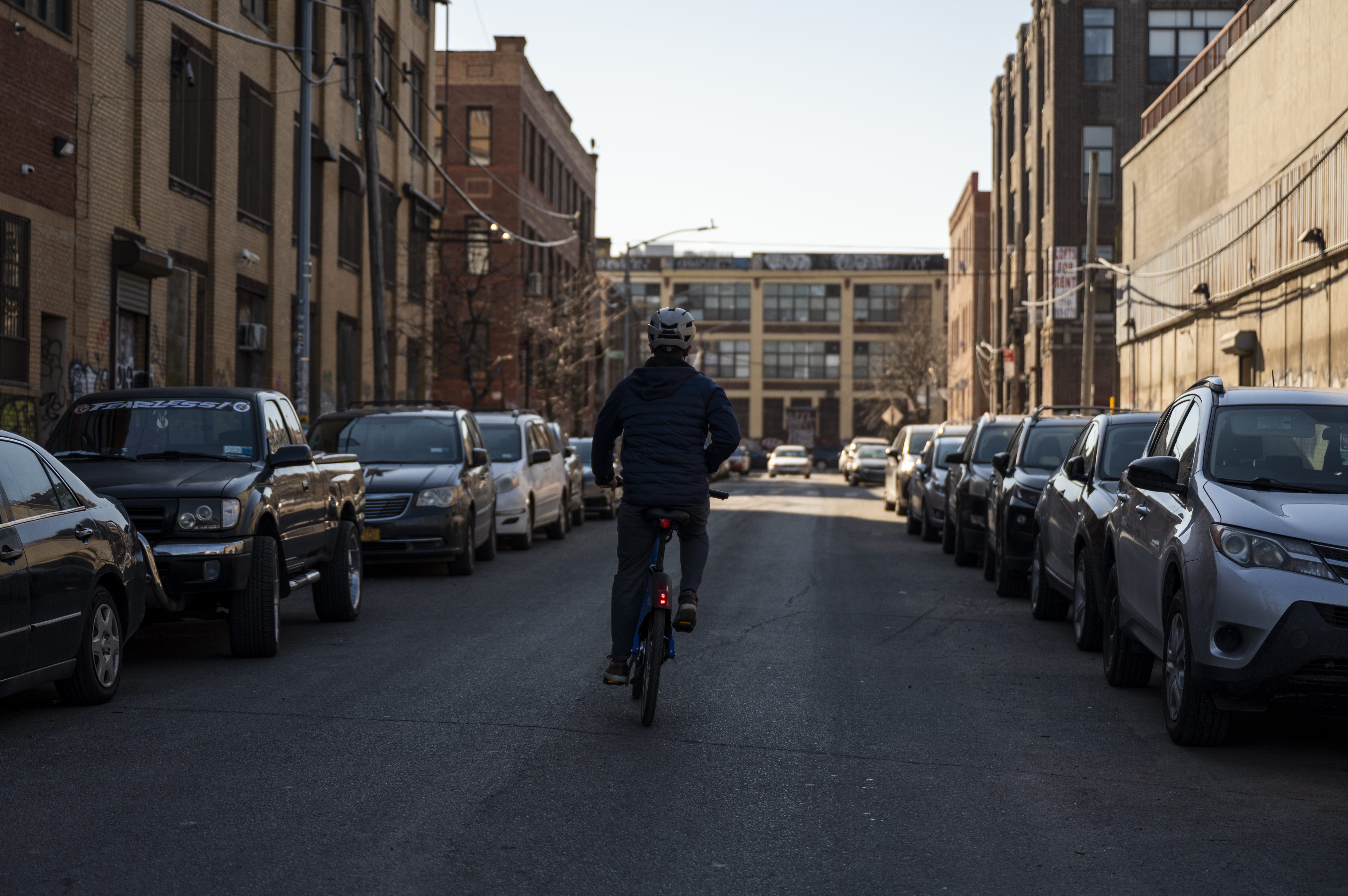 Edgardo Rivera bikes down a street in Bushwick. Feb. 26, 2021.