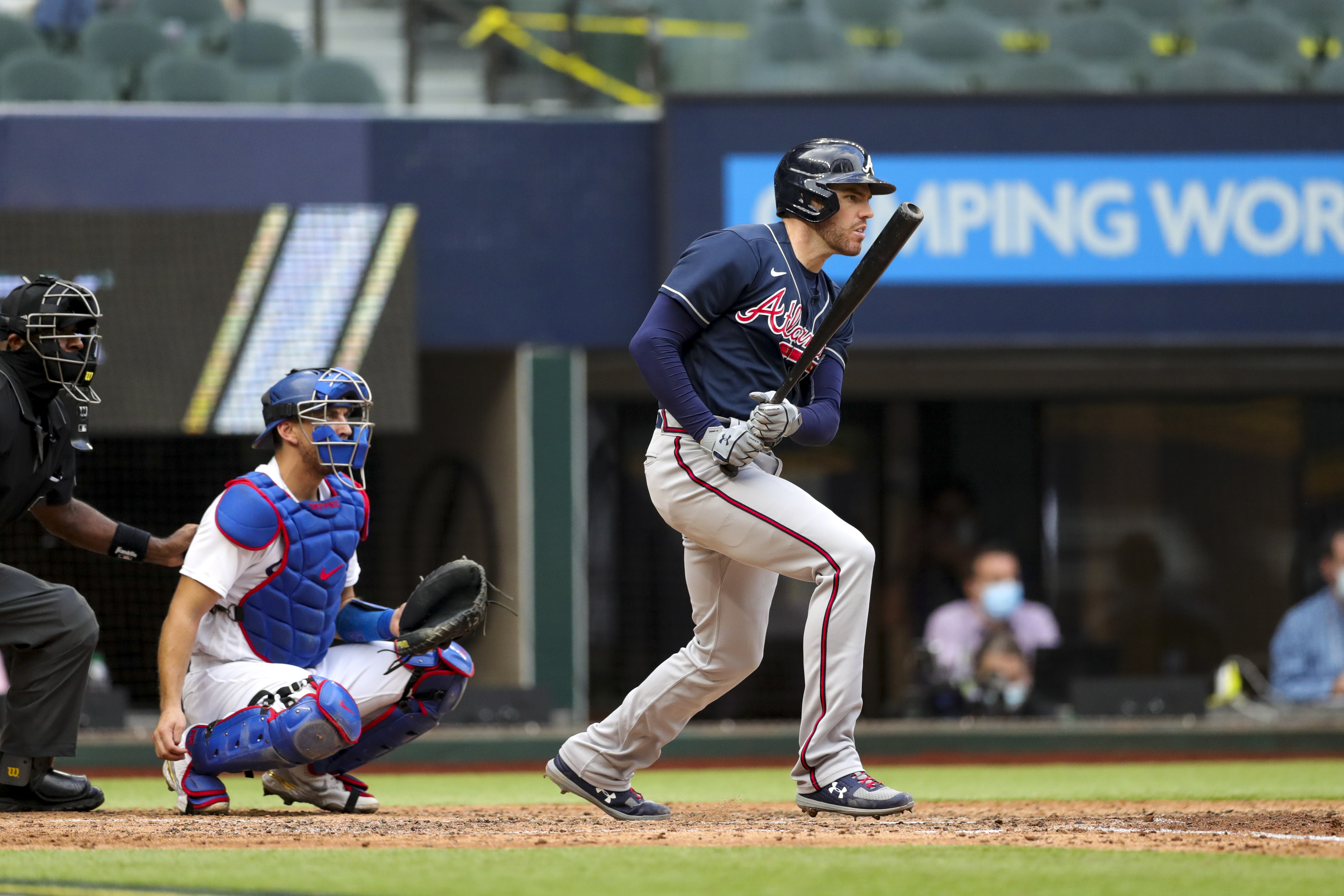 Freddie Freeman #5 of the Atlanta Braves singles in the fifth inning during Game 6 of the NLCS between the Atlanta Braves and the Los Angeles Dodgers at Globe Life Field on Saturday, October 17, 2020 in Arlington, Texas.