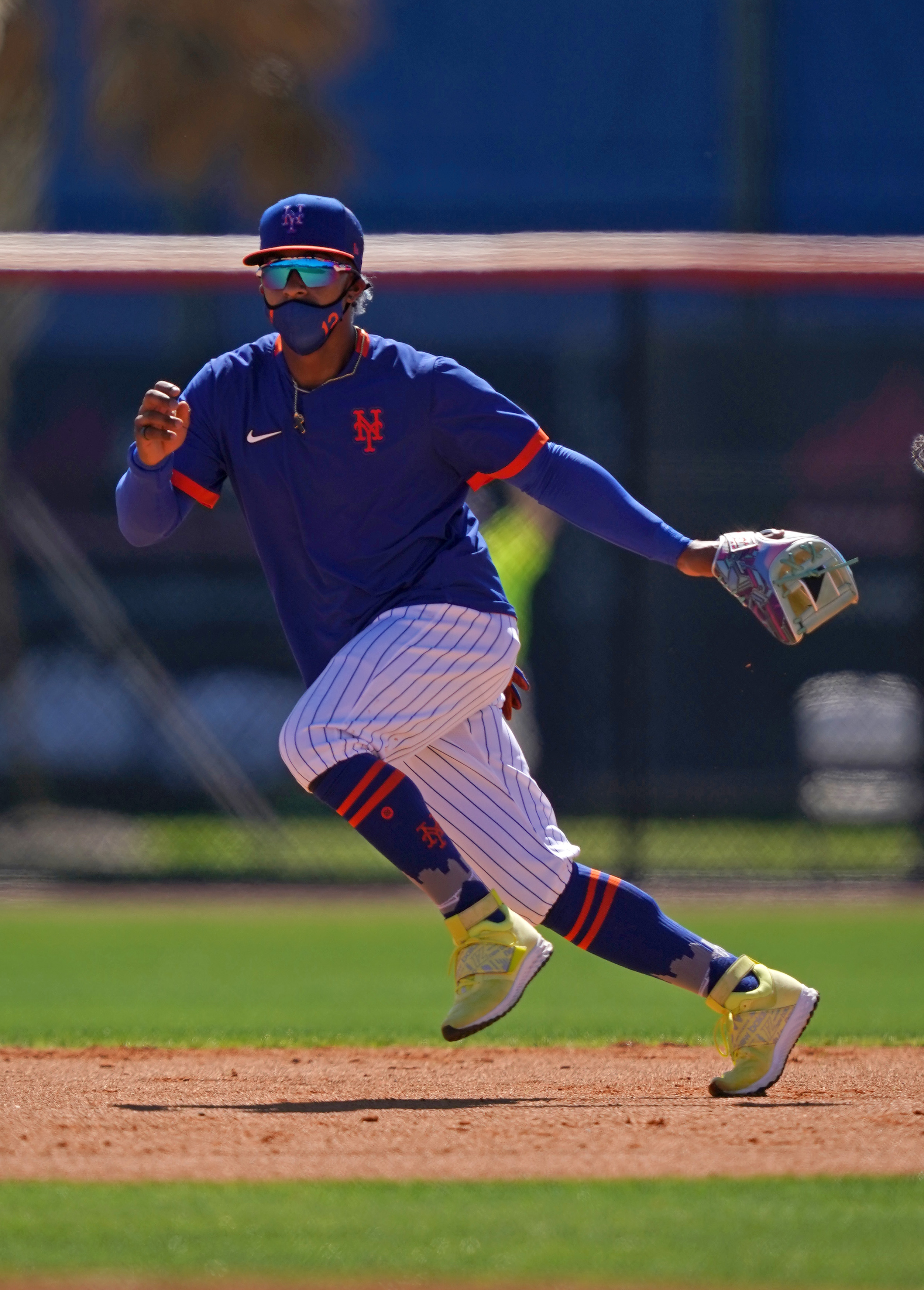 New York Mets shortstop Francisco Lindor (12) takes infield practice during spring training workouts at Clover Park.