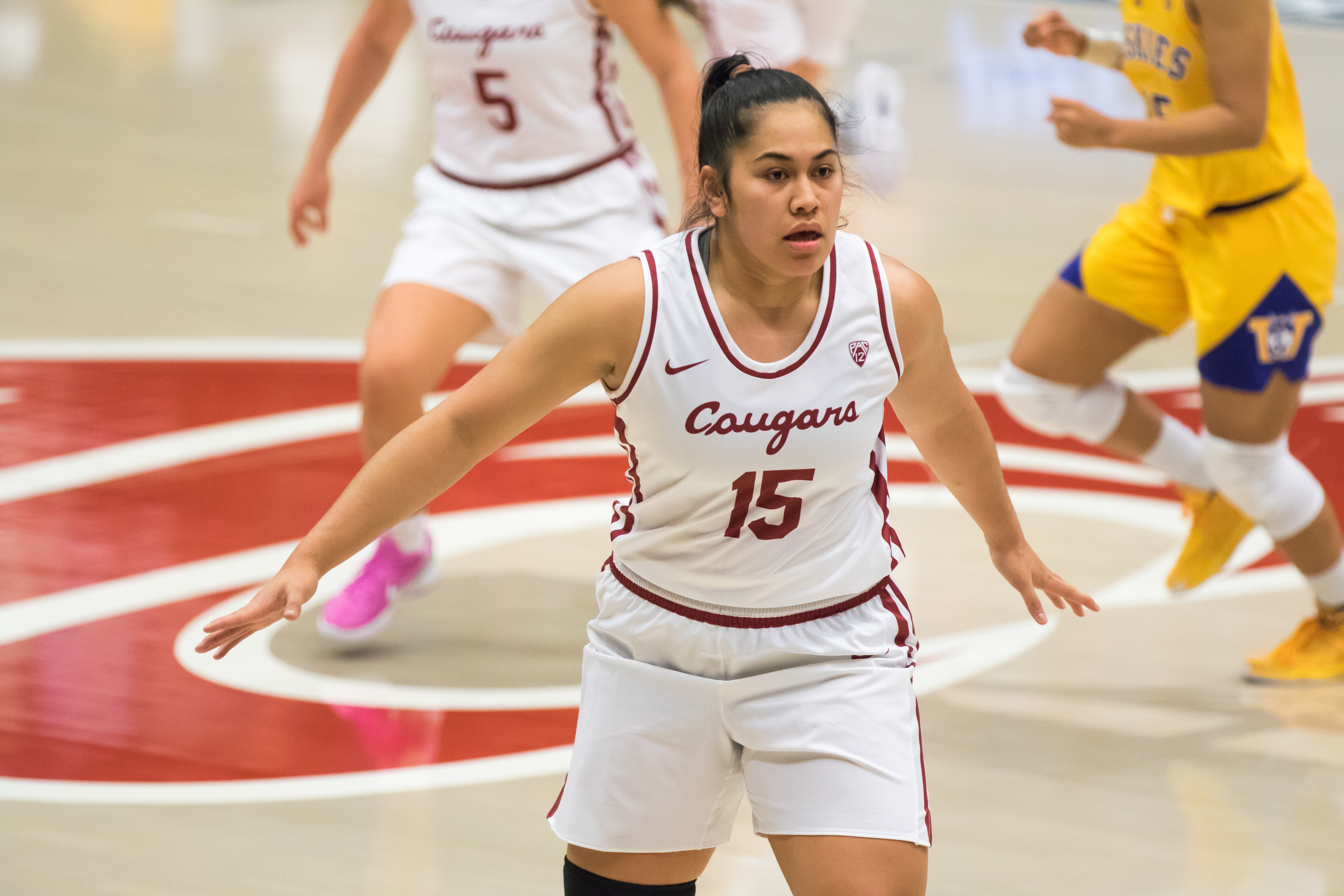 PULLMAN, WA - FEBRUARY 28: Washington State forward Ula Motuga (15) stares down a Washington player during the second half of a Boeing Apple Cup Series matchup between the Washington Huskies and the Washington State Cougars on February 28, 2021, at Beasley Coliseum in Pullman, WA.