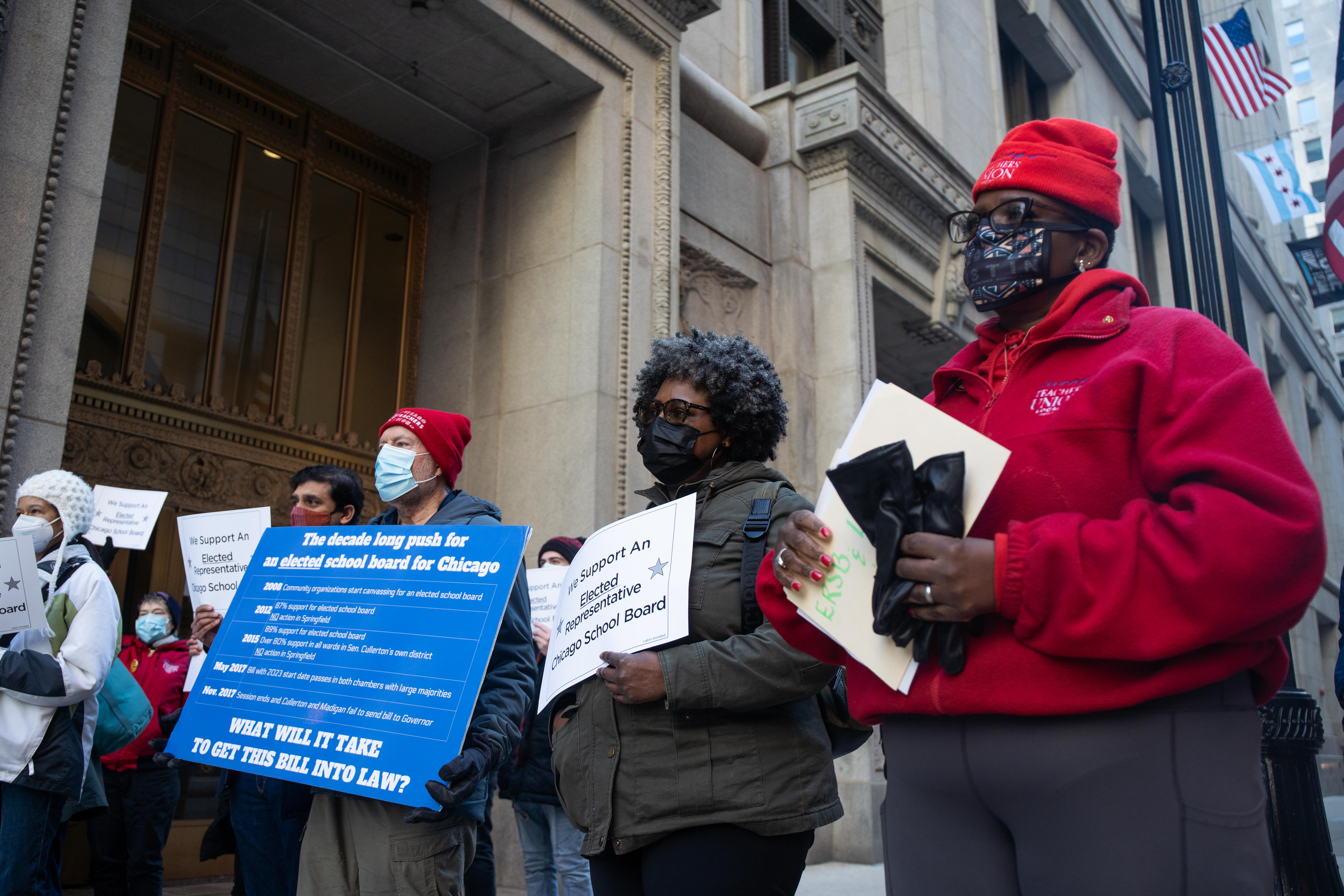 Members of the Grassroots Education Movement, which is composed of parents of Chicago Public Schools students and community leaders, outside City Hall in the Loop, Wednesday morning, March 3, 2021.