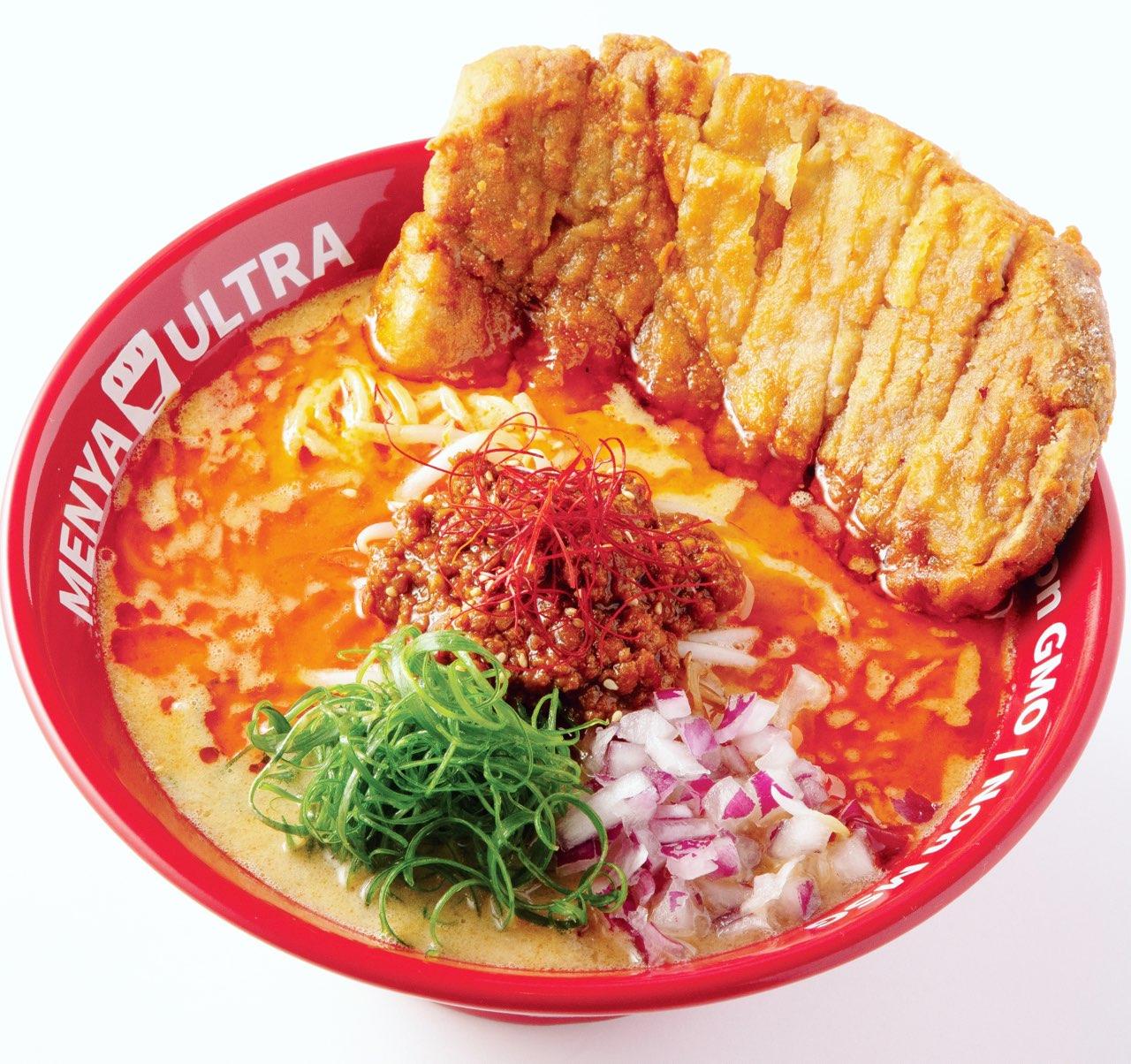 Bowl of spicy ramen and pork cutlet from Menya Ultra Ramen
