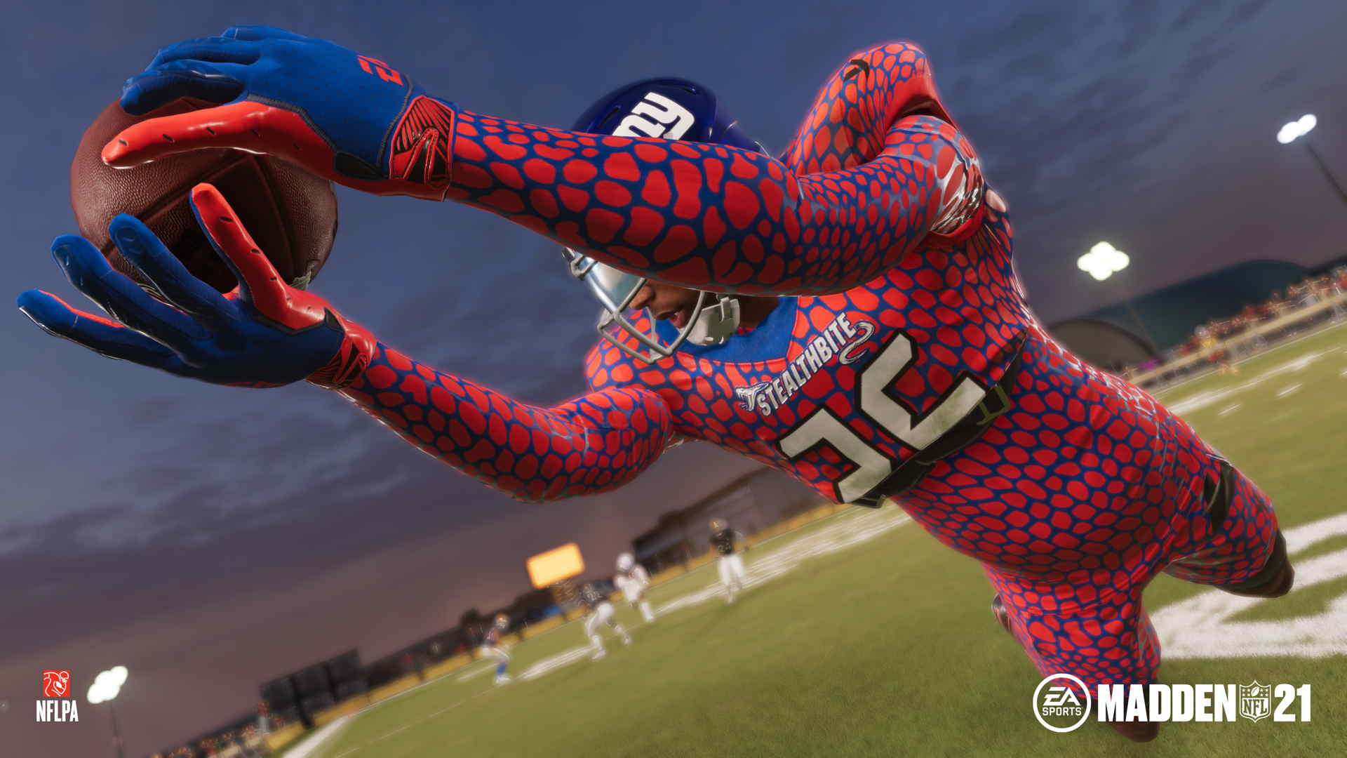 Giants running back Saquon Barkley, in a wild orange-and-blue snakeskin uniform, makes a diving grab in Madden NFL 21's The Yard