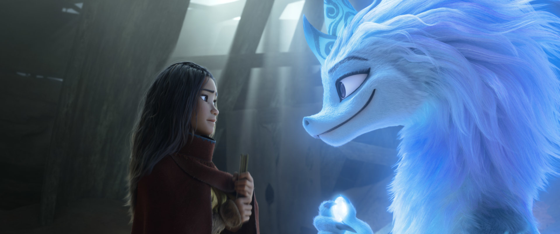 Raya, voiced by Kelly Marie Tran, seeks the help of the legendary dragon Sisu, voiced by Awkwafina.