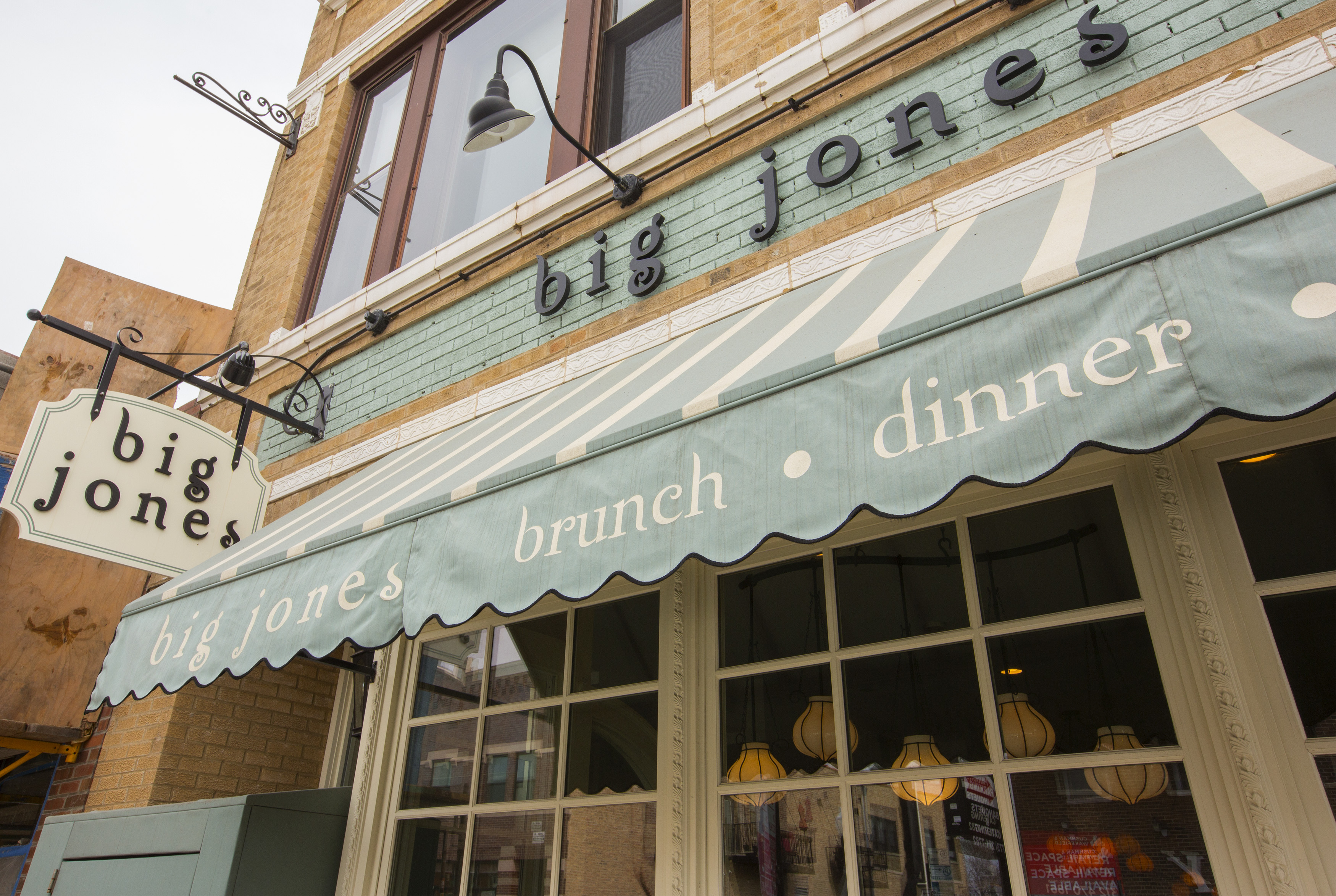 "A restaurant storefront that reads ""Big Jones"""